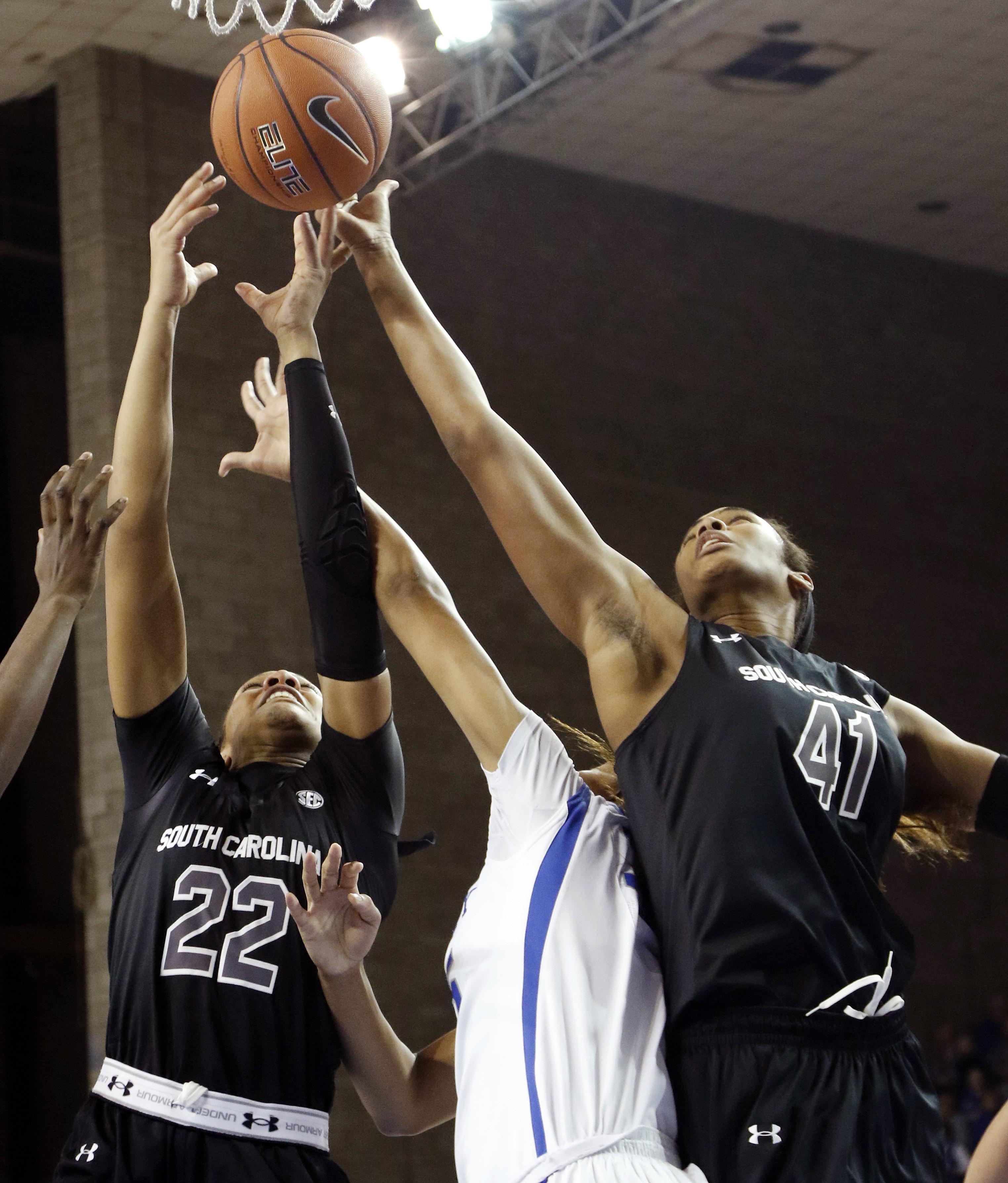 South Carolina's A'ja Wilson (22) and Alaina Coates (41) go for a rebound near Kentucky's Alexis Jennings during an NCAA college basketball game Thursday, Jan. 14, 2016, in Lexington, Ky. (AP Photo/James Crisp)
