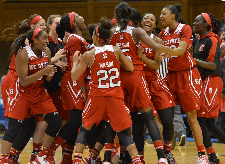 North Carolina State celebrates a 65-52 win over No. 22 Duke during an NCAA college basketball game Thursday, Jan. 14, 2016, in Durham, N.C. (Bernard Thoms/The Herald-Sun via AP) Mandatory Credit