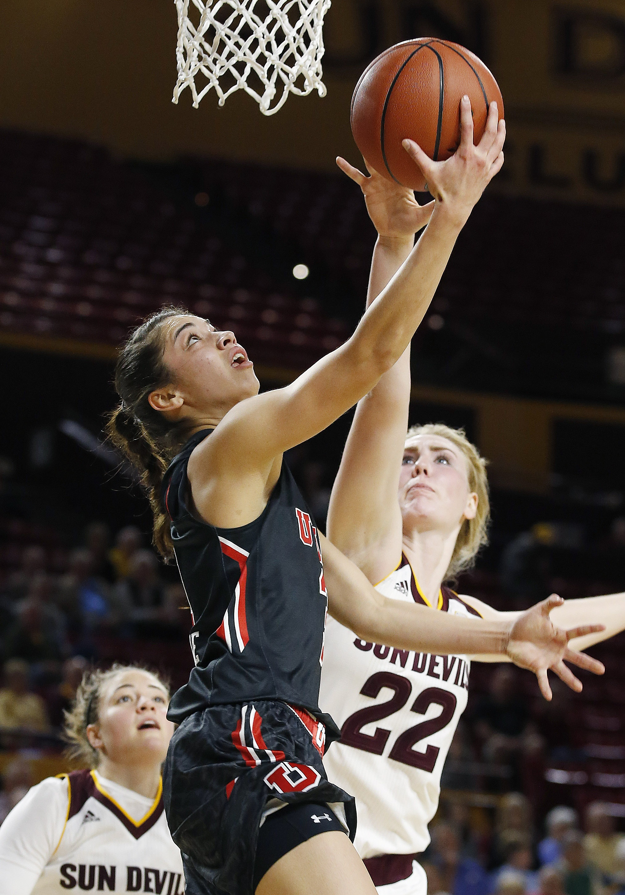Utah's Malia Nawahine, center, shoots as she gets past Arizona State's Quinn Dornstauder (22) and Katie Hempen, left, during the first half of an NCAA college basketball game Sunday, Jan. 17, 2016, in Tempe, Ariz. (AP Photo/Ross D. Franklin)