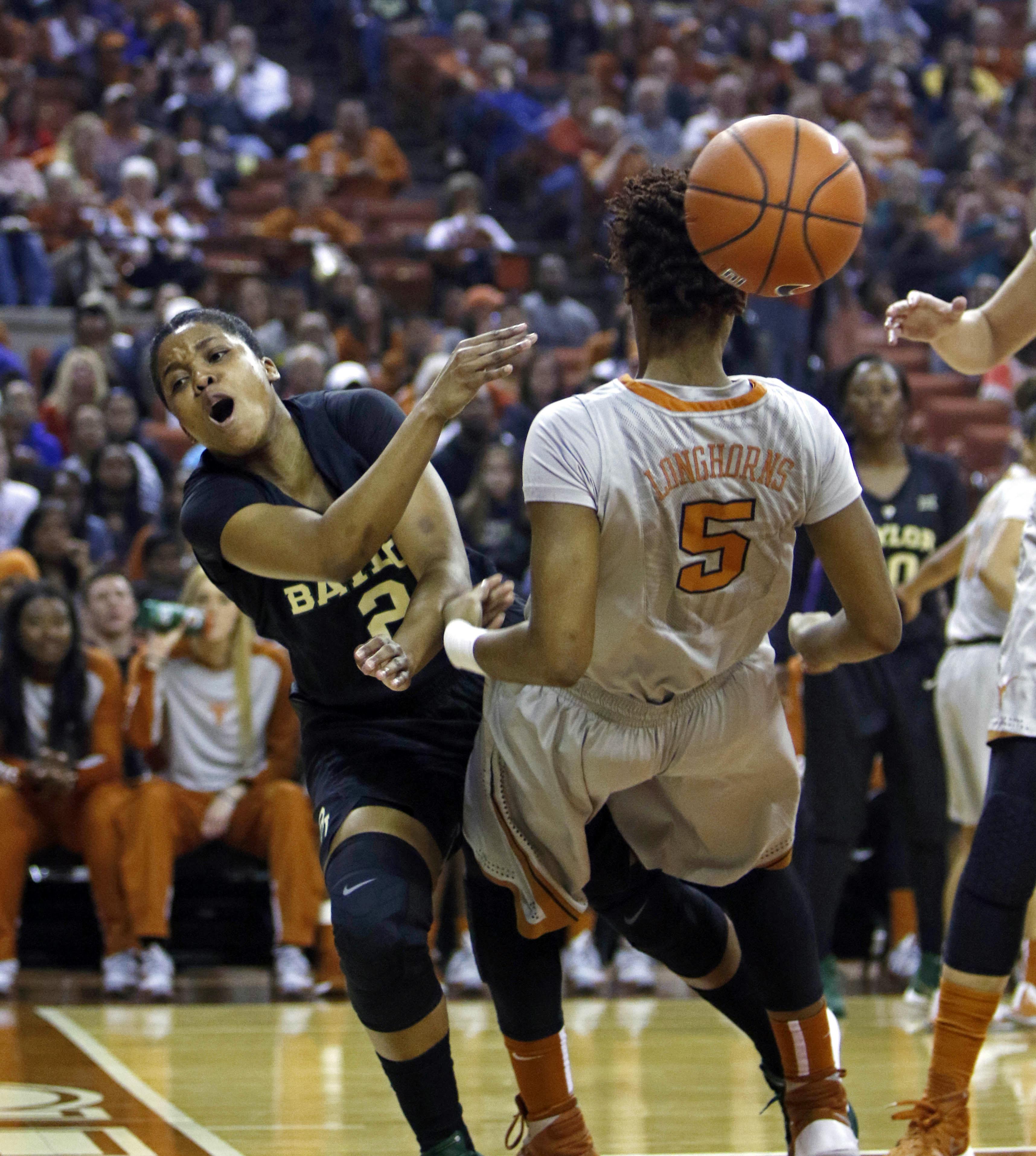 Baylor guard Niya Johnson (2) is fouled by Texas forward Jordan Hosey (5) during the first half of an NCAA college basketball game, Sunday, Jan. 17, 2016, in Austin, Texas. (AP Photo/Michael Thomas)