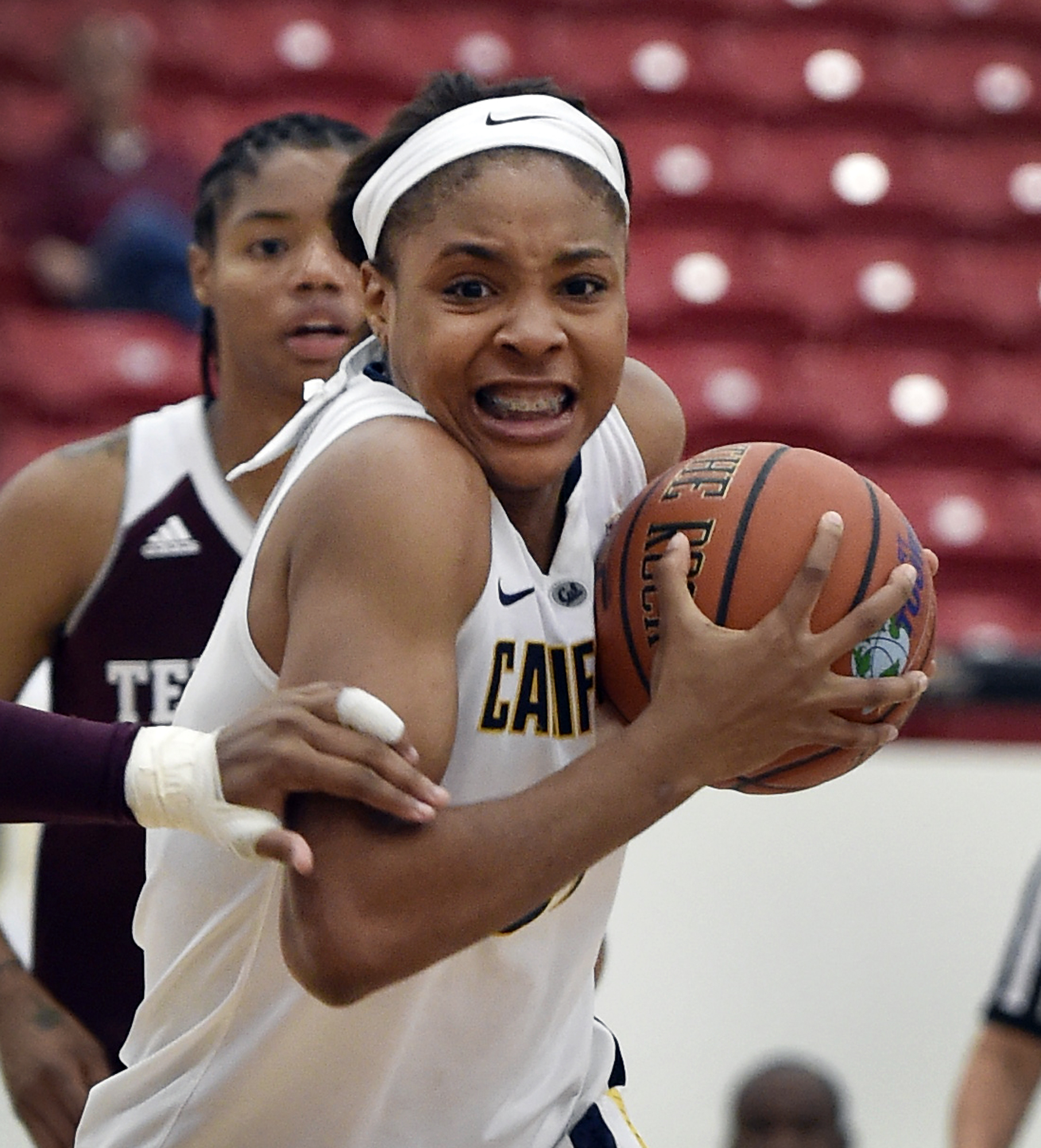 FILe - In this Nov. 27, 2015, file photo, California's Kristine Anigwe drives to the basket against Texas A&M during the first half of an NCAA college basketball game, in Las Vegas. Cal freshman Kristine Anigwe is doing just about everything for the Golde