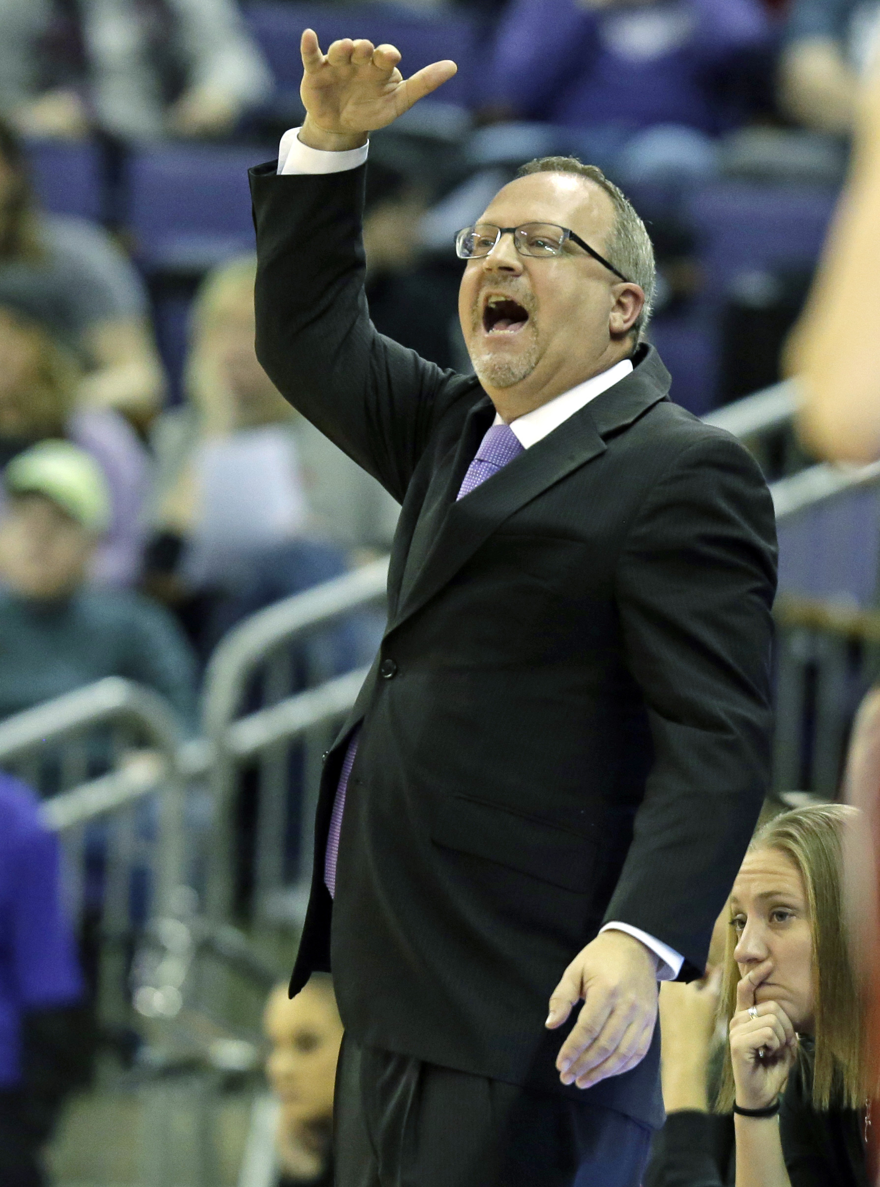 Washington head coach Mike Neighbors gestures from the bench during the second half of an NCAA college basketball game against Washington State, Saturday, Jan. 23, 2016, in Seattle. (AP Photo/Ted S. Warren)