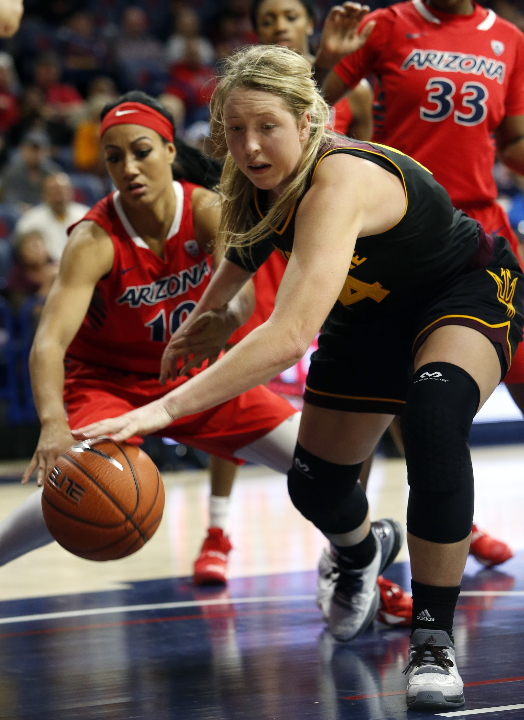 Arizona State forward Kelsey Moos steals the ball from Arizona guard Lauren Evans (10) during the fourth quarter of an NCAA college basketball game, Sunday, Jan. 24, 2016, in Tucson, Ariz. (AP Photo/Rick Scuteri)
