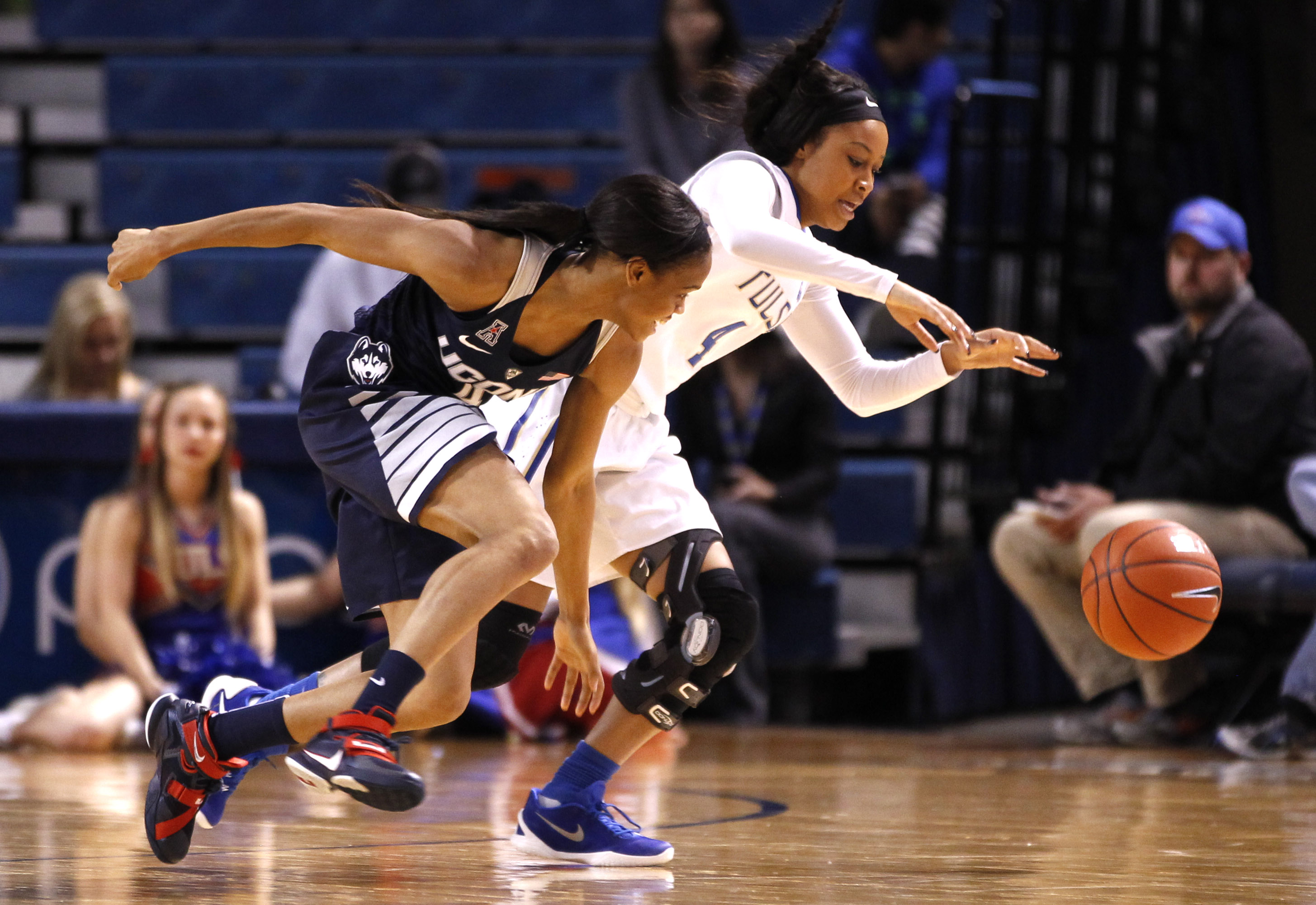 Connecticut's Moriah Hefferson and Tulsa's Teanna Reid chase a loose ball in the first half of an NCAA college basketball game in Tulsa, Okla., Wednesday, Jan. 27, 2016. (AP Photo/Dave Crenshaw)