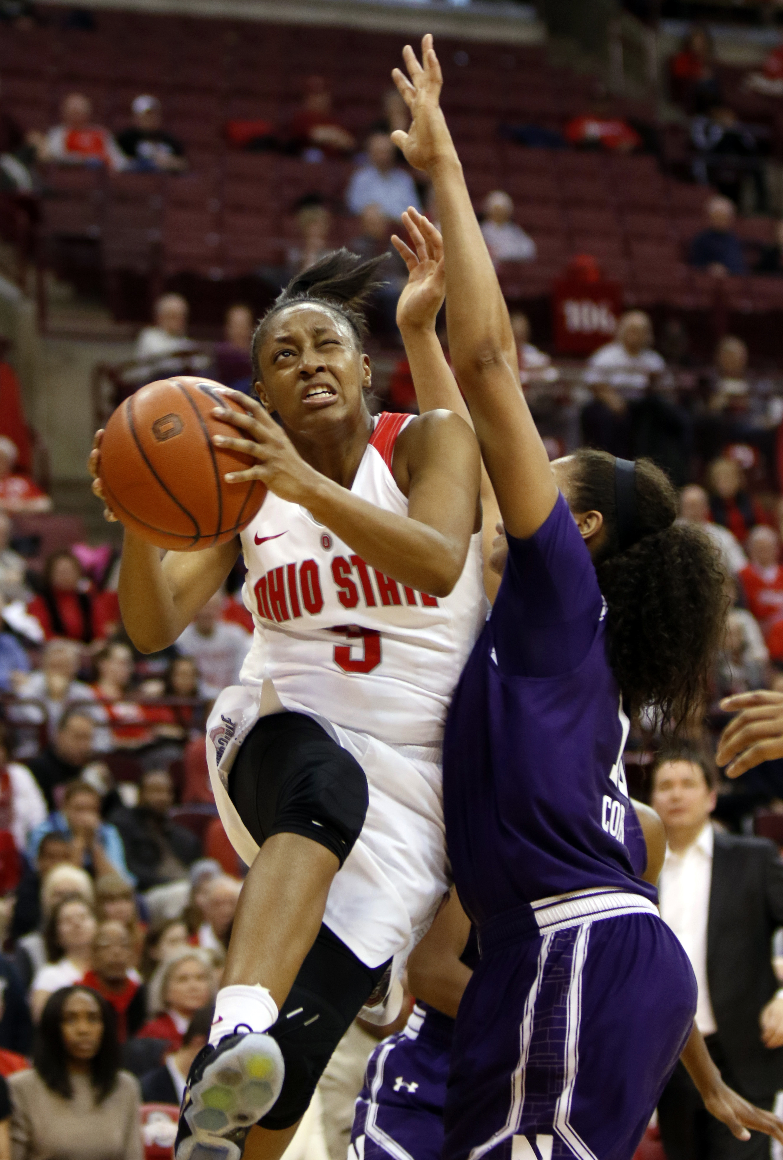 Ohio State's Kelsey Mitchell, left, goes up to shoot against Northwestern's Nia Coffey during the second half of an NCAA college basketball game in Columbus, Ohio, Thursday, Jan. 28, 2016. Ohio State won 76-73. (AP Photo/Paul Vernon)