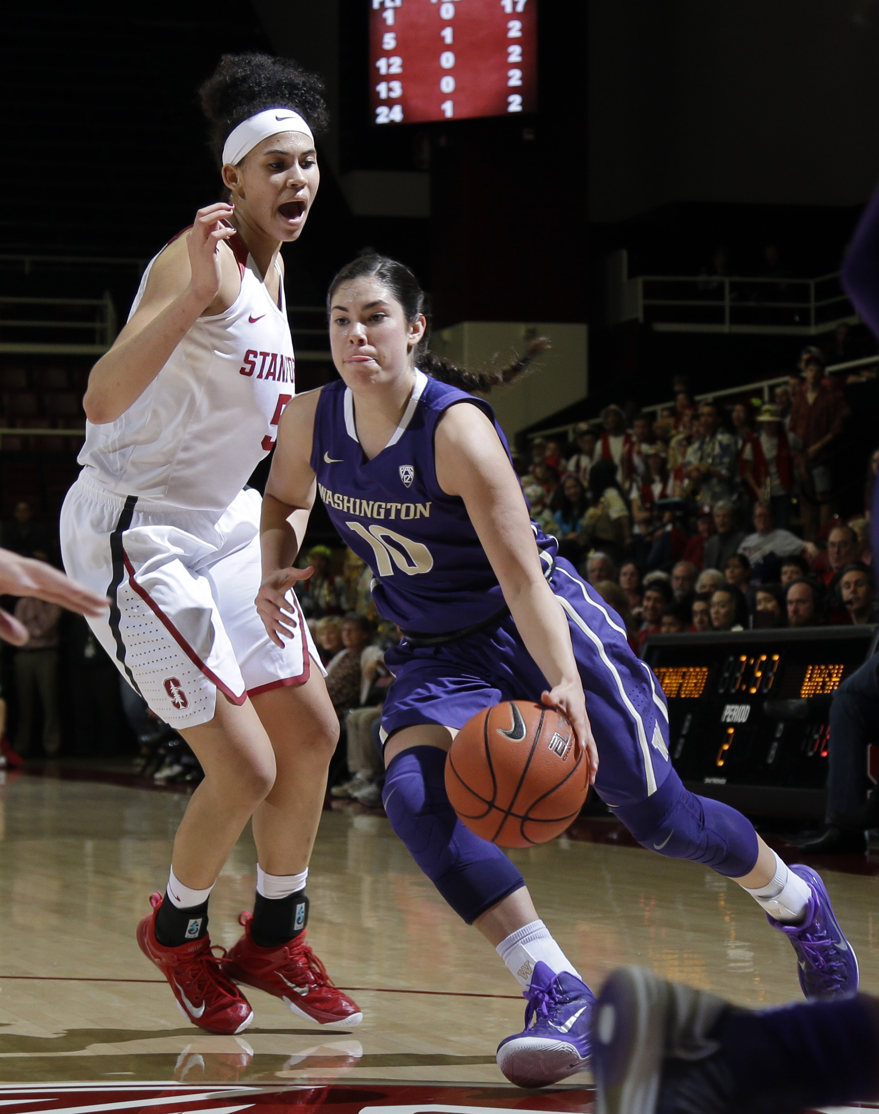 Washington guard Kelsey Plum (10) dribbles past Stanford forward Kaylee Johnson during the first half of an NCAA college basketball game Friday, Jan. 29, 2016, in Stanford, Calif. (AP Photo/Marcio Jose Sanchez)