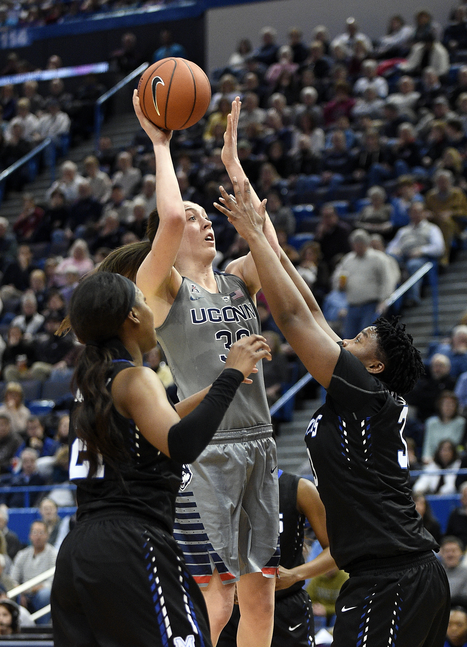 Connecticut's Breanna Stewart (30) shoots over Memphis' Asianna Fuqua-Bey, left, and Brianna Wright during the first half of an NCAA college basketball game in Hartford, Conn., on Saturday, Jan. 30, 2016. (AP Photo/Fred Beckham)