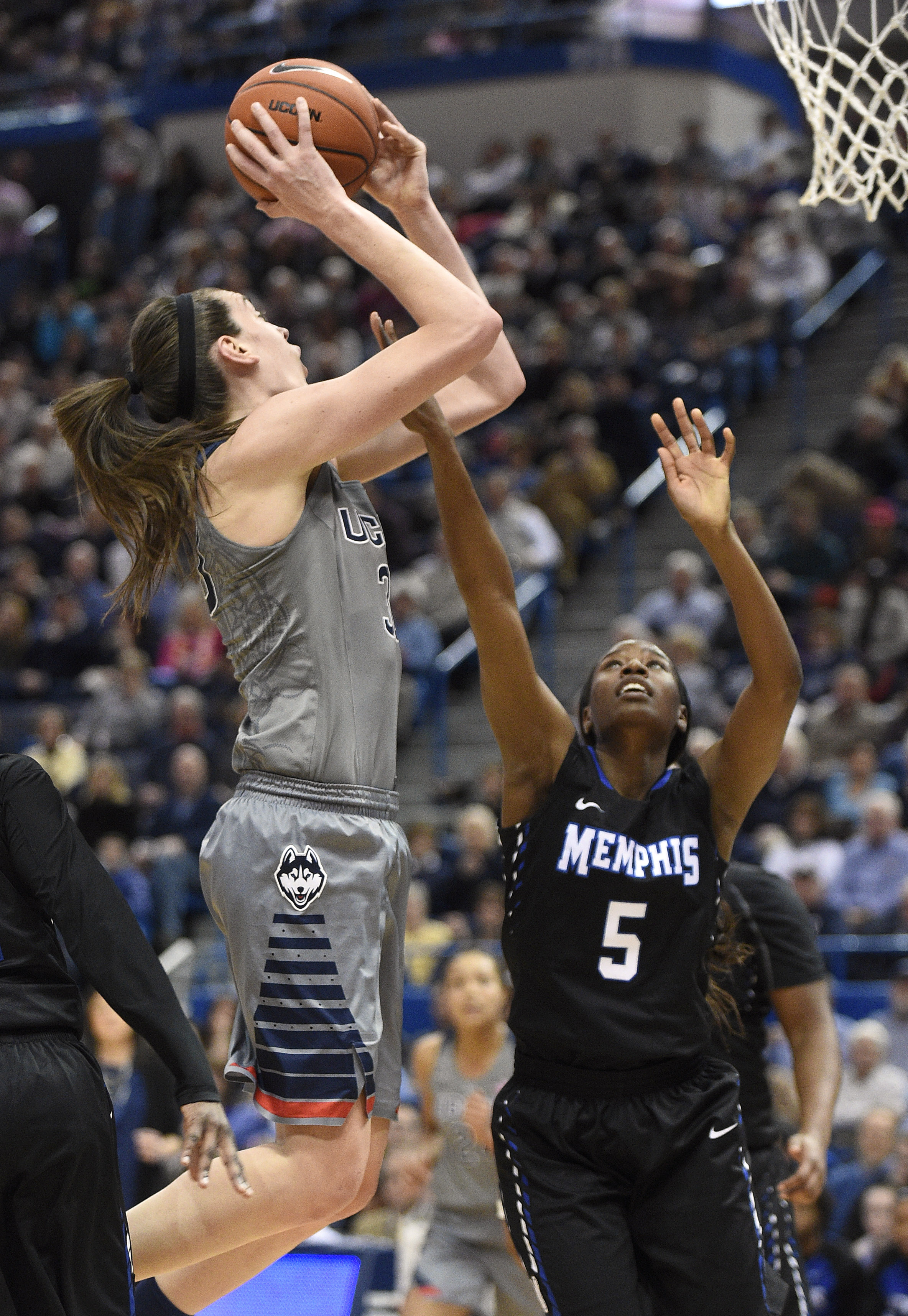 Connecticut's Breanna Stewart (30) shoots over Memphis' Brea Elmore during the first half of an NCAA college basketball game in Hartford, Conn., on Saturday, Jan. 30, 2016. Connecticut won the game 83-40. (AP Photo/Fred Beckham)