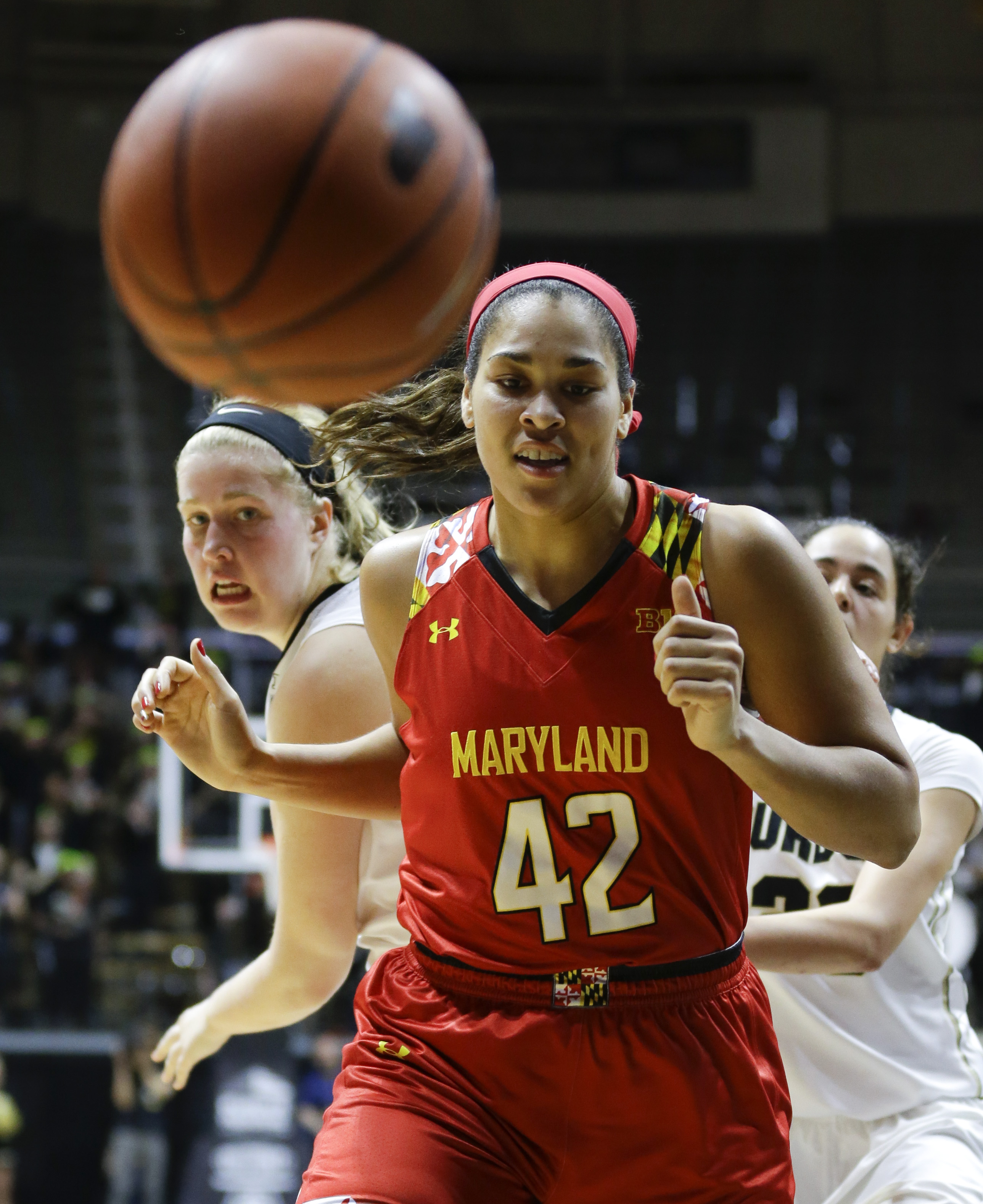 Maryland center Brionna Jones (42) and Purdue guard Bridget Perry (13) watch as the ball is knocked out of bounds during the first half of an NCAA college basketball game in West Lafayette, Ind., Tuesday, Feb. 2, 2016. (AP Photo/Michael Conroy)