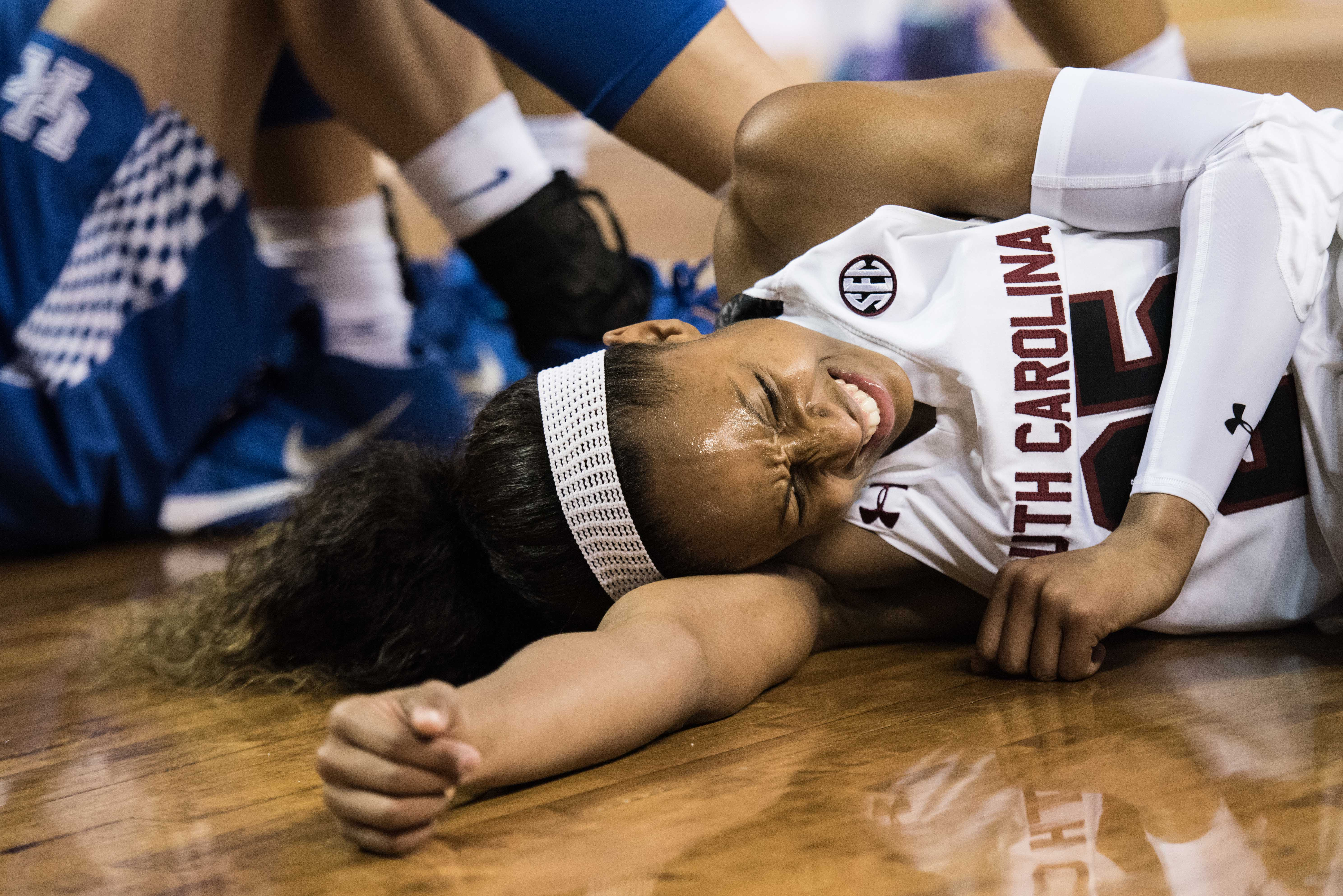 South Carolina guard Tiffany Mitchell (25) grimaces in pain after an injury during the first half of an NCAA college basketball game against Kentucky Thursday, Feb. 4, 2016, in Columbia, S.C. (AP Photo/Sean Rayford)