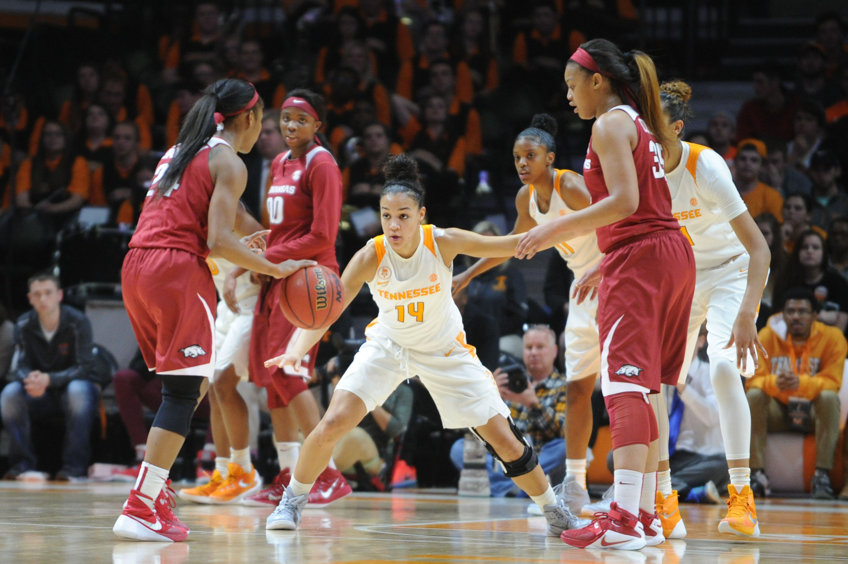 Tennessee guard Andraya Carter (14) defends Arkansas guard Jordan Danberry (24) during the first half of a NCAA college basketball game on Thursday, Feb. 4, 2016, in Knoxville, Tenn. Tennessee defeated Arkansas 75-57. (Caitie McMekin/Knoxville News Sentin