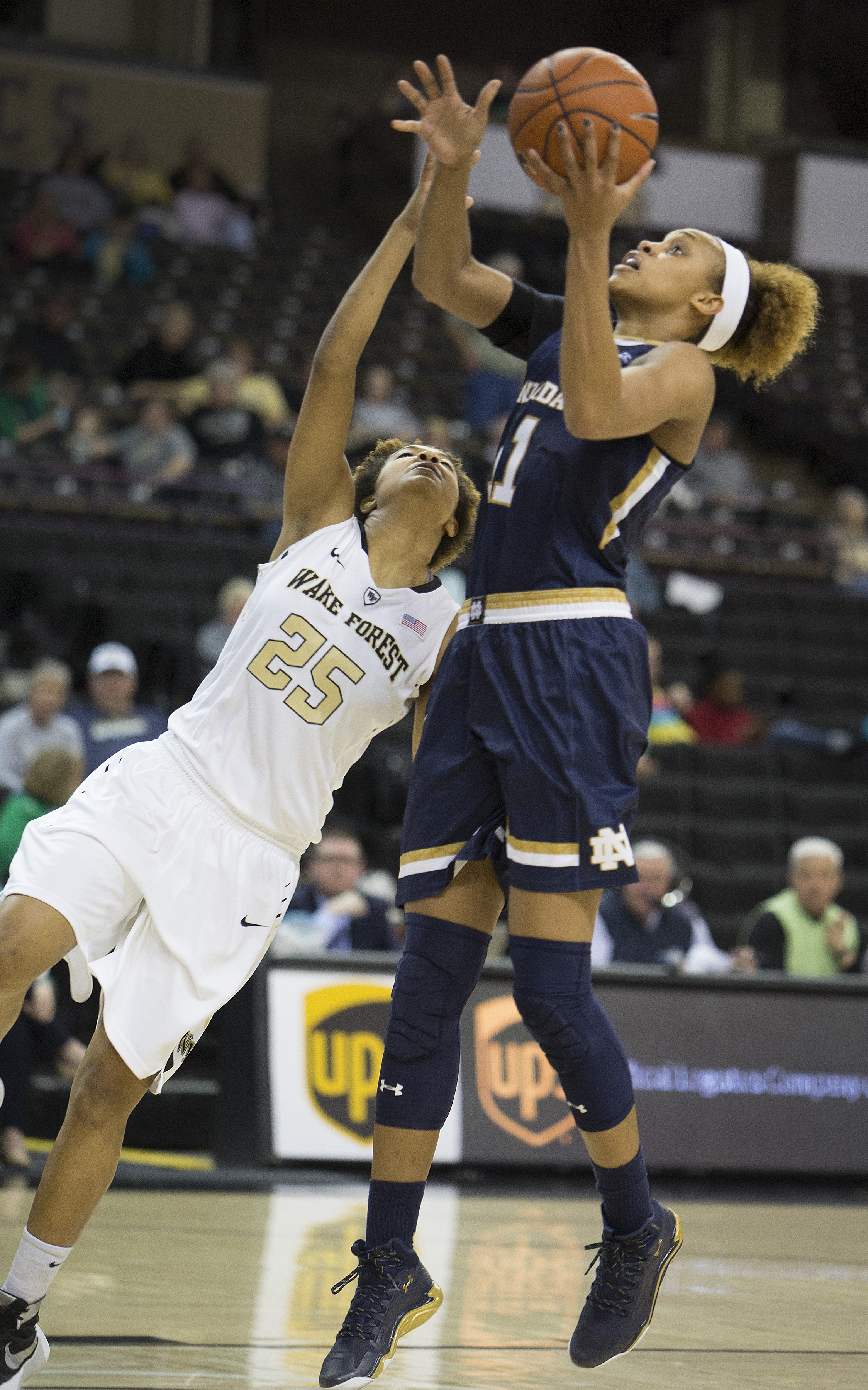 Notre Dame's Brianna Turner (11) shoots with Wake Forest's Ariel Stephenson (25) falling away in the second half of an NCAA college basketball game Thursday, Feb. 18, 2016, in Winston-Salem, N.C. Notre Dame wins 86-52. (AP Photo/Lynn Hey)