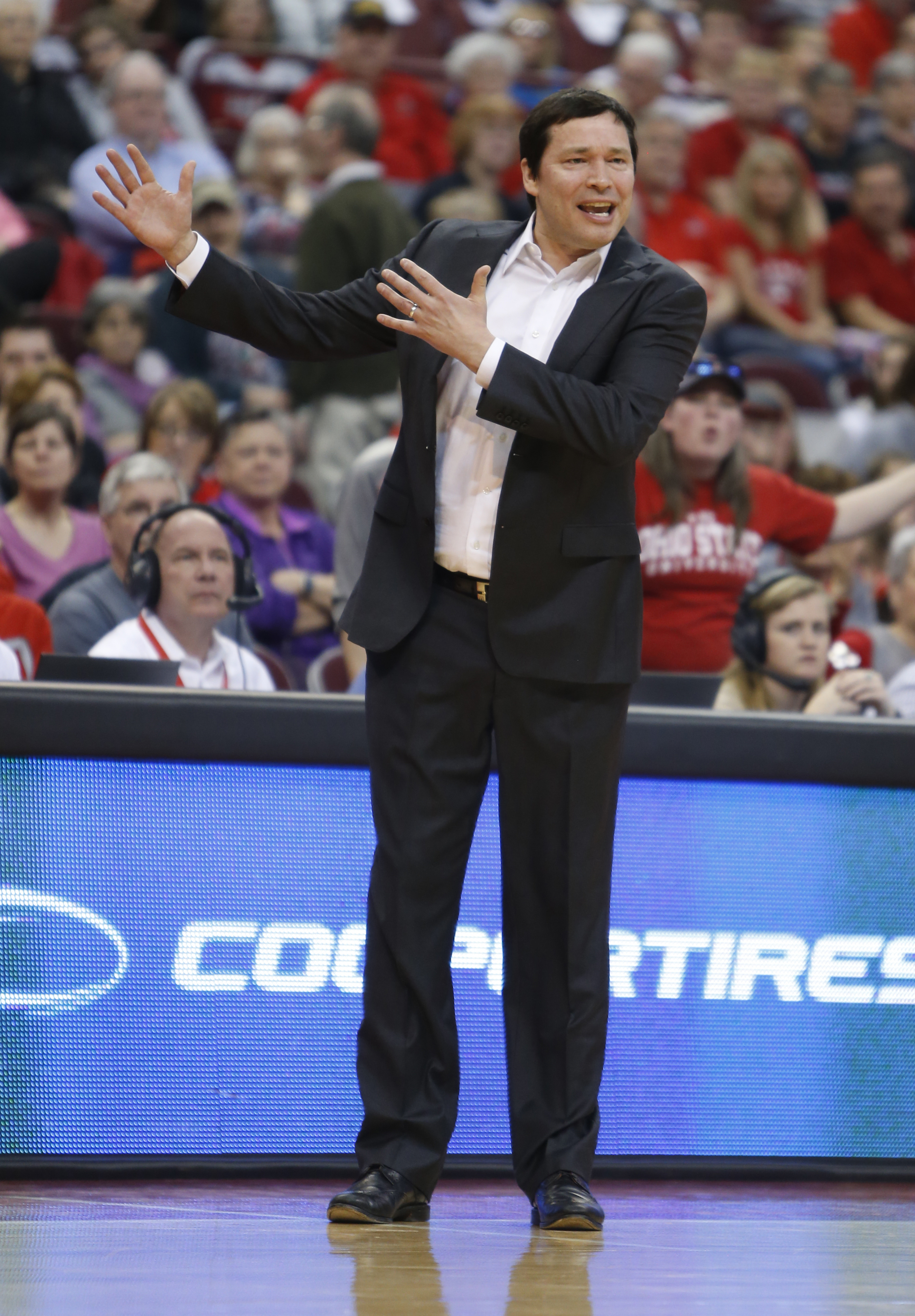 Ohio State head coach Kevin McGuff instructs his team against Illinois during the first half of an NCAA college basketball game Sunday, Feb. 21, 2016, in Columbus, Ohio. Ohio State beat Illinois 117-74. (AP Photo/Jay LaPrete)