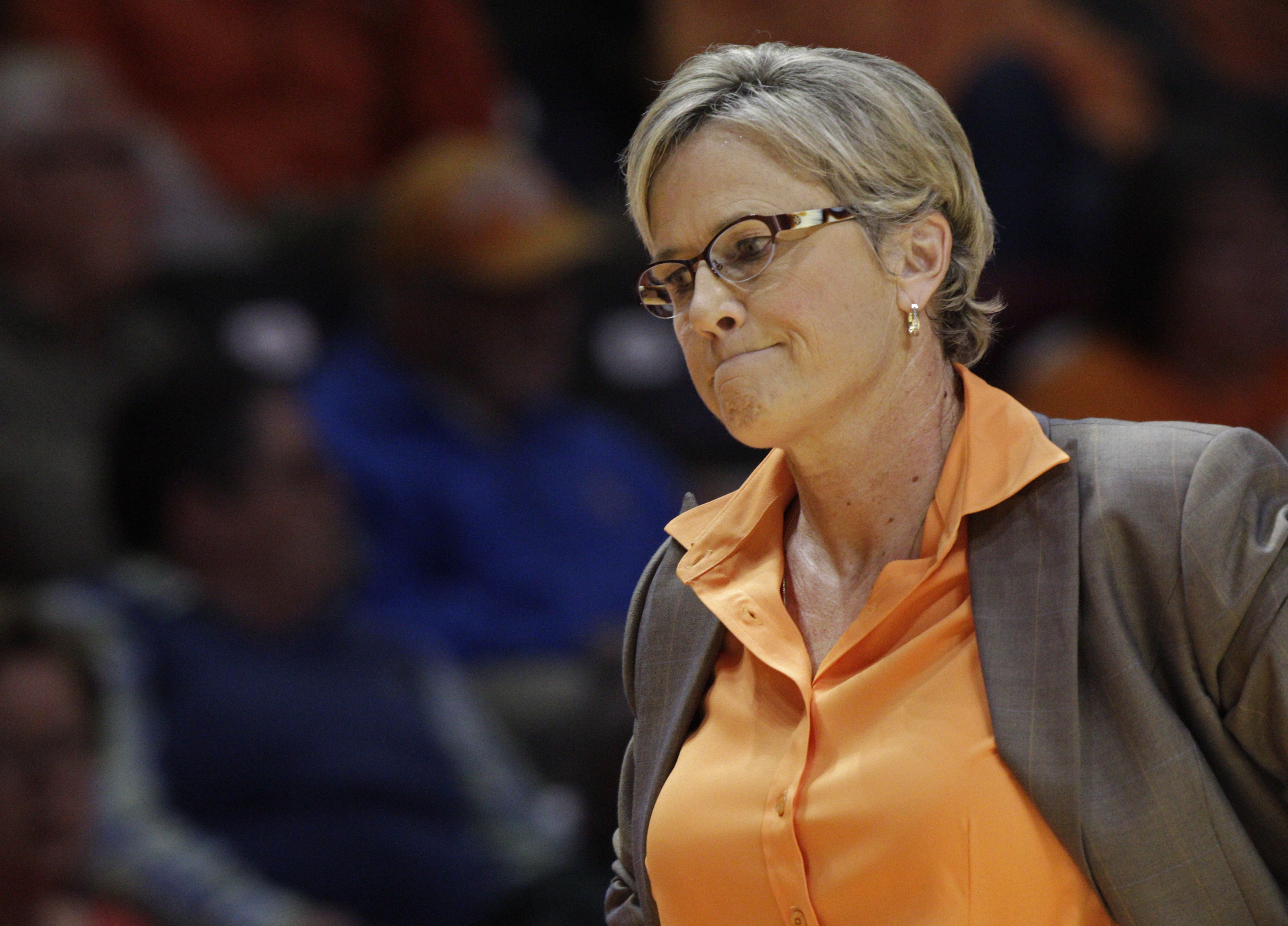 FILE - In this Nov. 29, 2015, file photo, Tennessee head coach Holly Warlick reacts to a call in the first half of an NCAA college basketball game against Texas, in Knoxville, Tenn. Tennessee's 31-year run in the Top 25 is over. The Lady Vols streak of 56