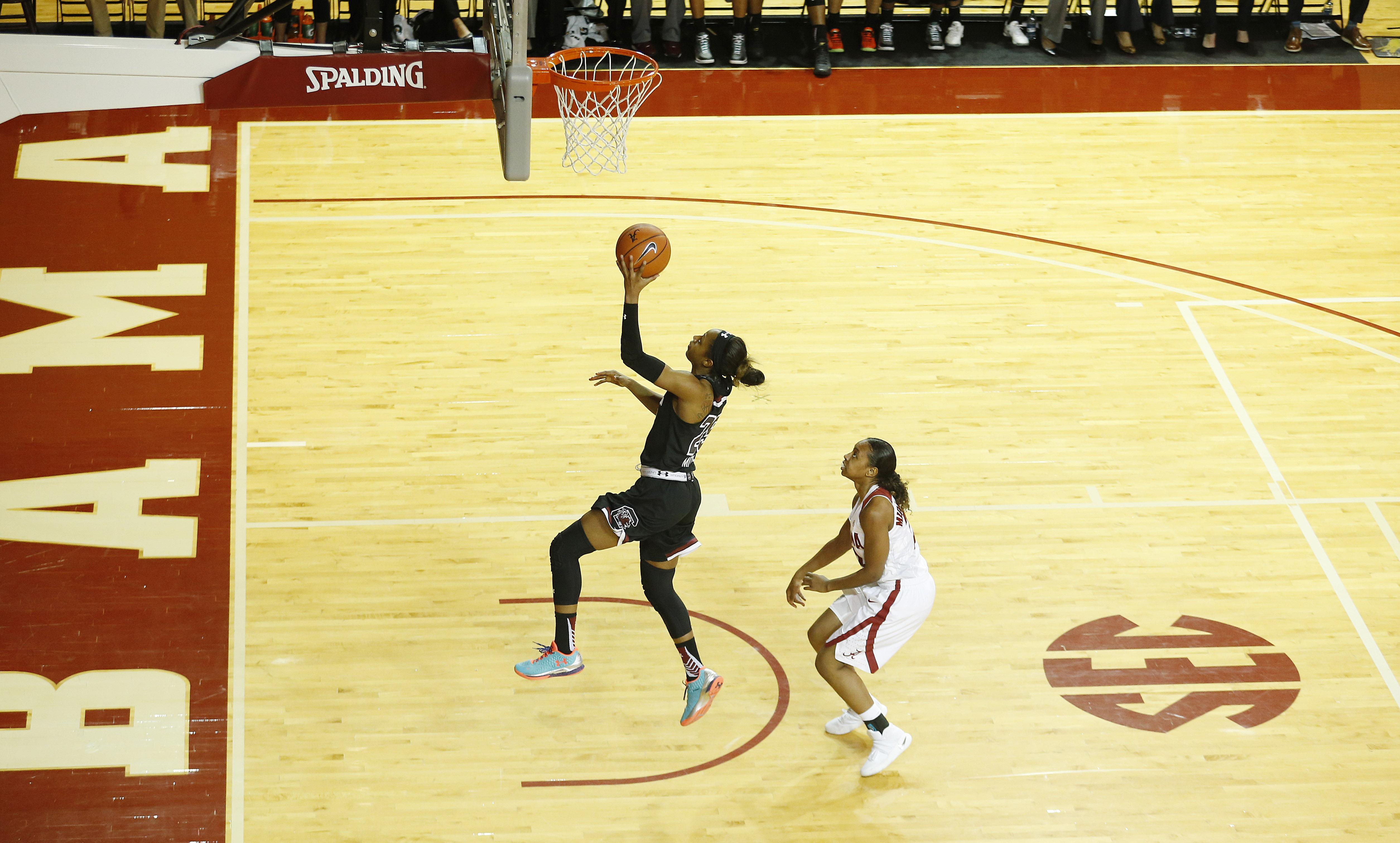 South Carolina guard Tiffany Mitchell, left, drives the ball to the basket and scores against Alabama guard Karyla Middlebrook, right, during the second half of an NCAA college basketball game, Monday, Feb. 22, 2016, in Tuscaloosa, Ala. (AP Photo/Brynn An