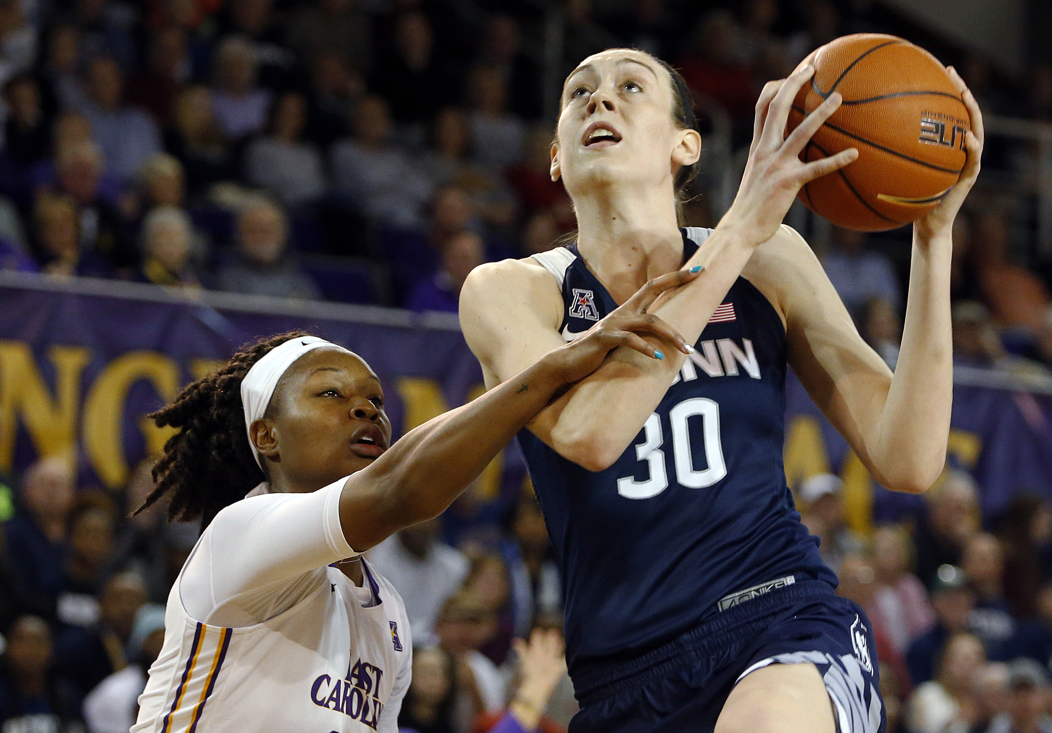 FILE - In this Saturday, Feb. 20, 2016, file photo, Connecticut's Breanna Stewart (30) drives the ball past East Carolina I'Tiana Taylor (24) during the first half of an NCAA college basketball game in Greenville, N.C. Stewart got a brief glimpse of her b