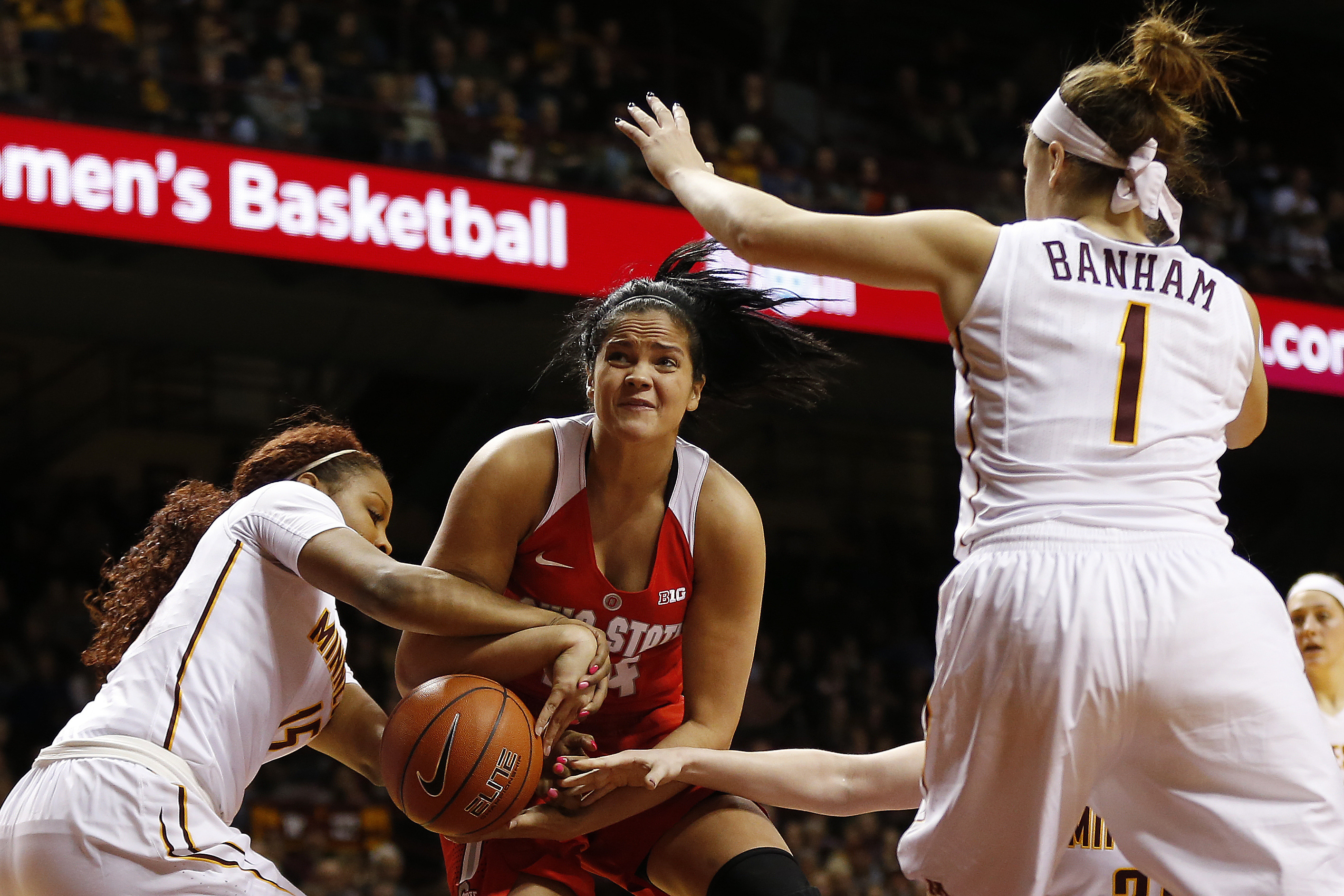 Ohio State forward Makayla Waterman, center, tries to hang onto the ball against Minnesota guard Allina Starr (15) in the first half of an NCAA college basketball game Wednesday, Feb. 24, 2016 in Minneapolis. (AP Photo/Stacy Bengs)