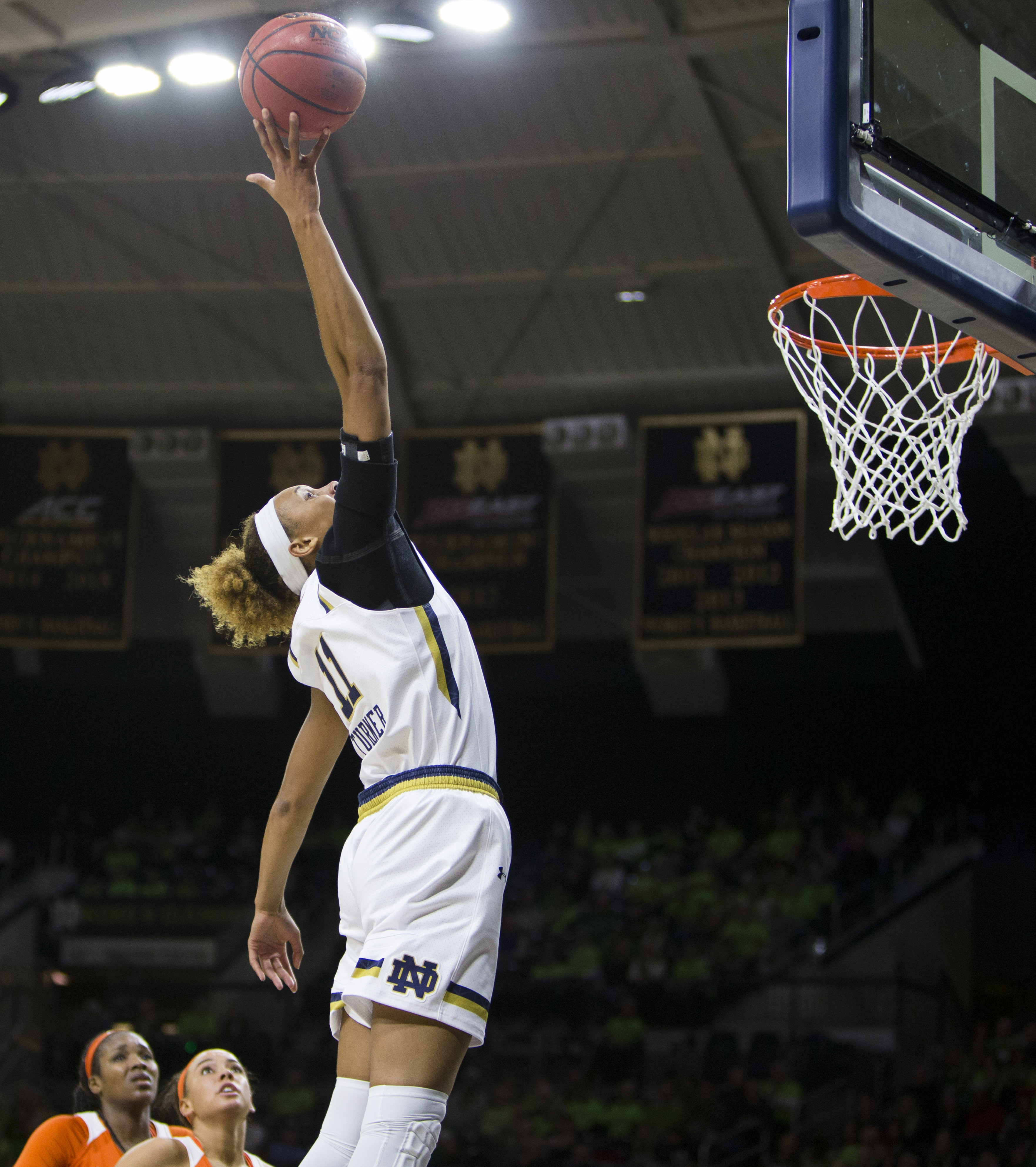 Notre Dame's Brianna Turner (11) jumps high for a tipped pass during the first half of an NCAA college basketball game against Clemson on Thursday, Feb. 25, 2016, in South Bend, Ind. (AP Photo/Robert Franklin)