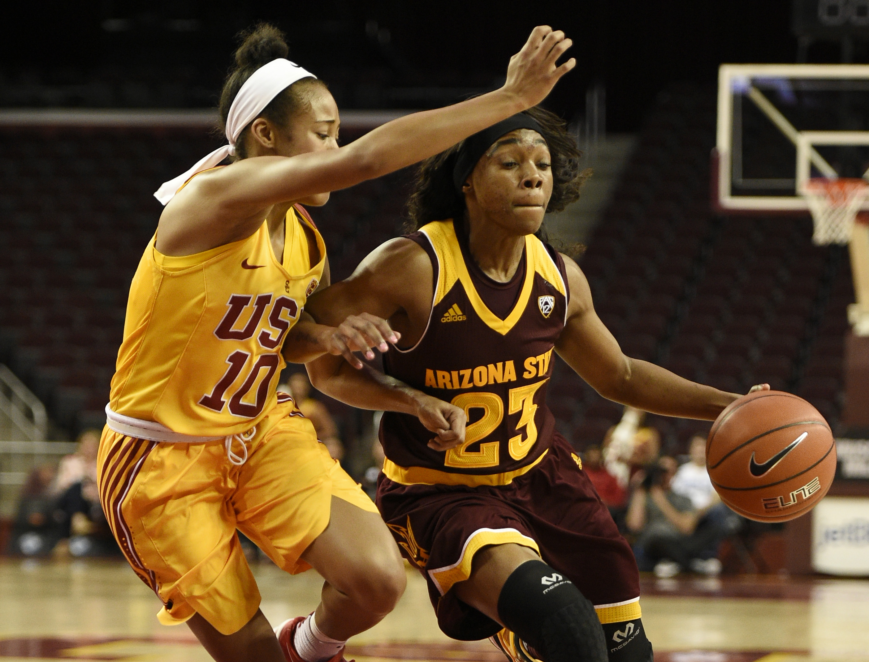 Arizona State guard Elisha Davis, right, drives the ball as Southern California guard Courtney Jaco defends during the first quarter of an NCAA college basketball game in Los Angeles, Friday, Feb. 26, 2016. (AP Photo/Kelvin Kuo)