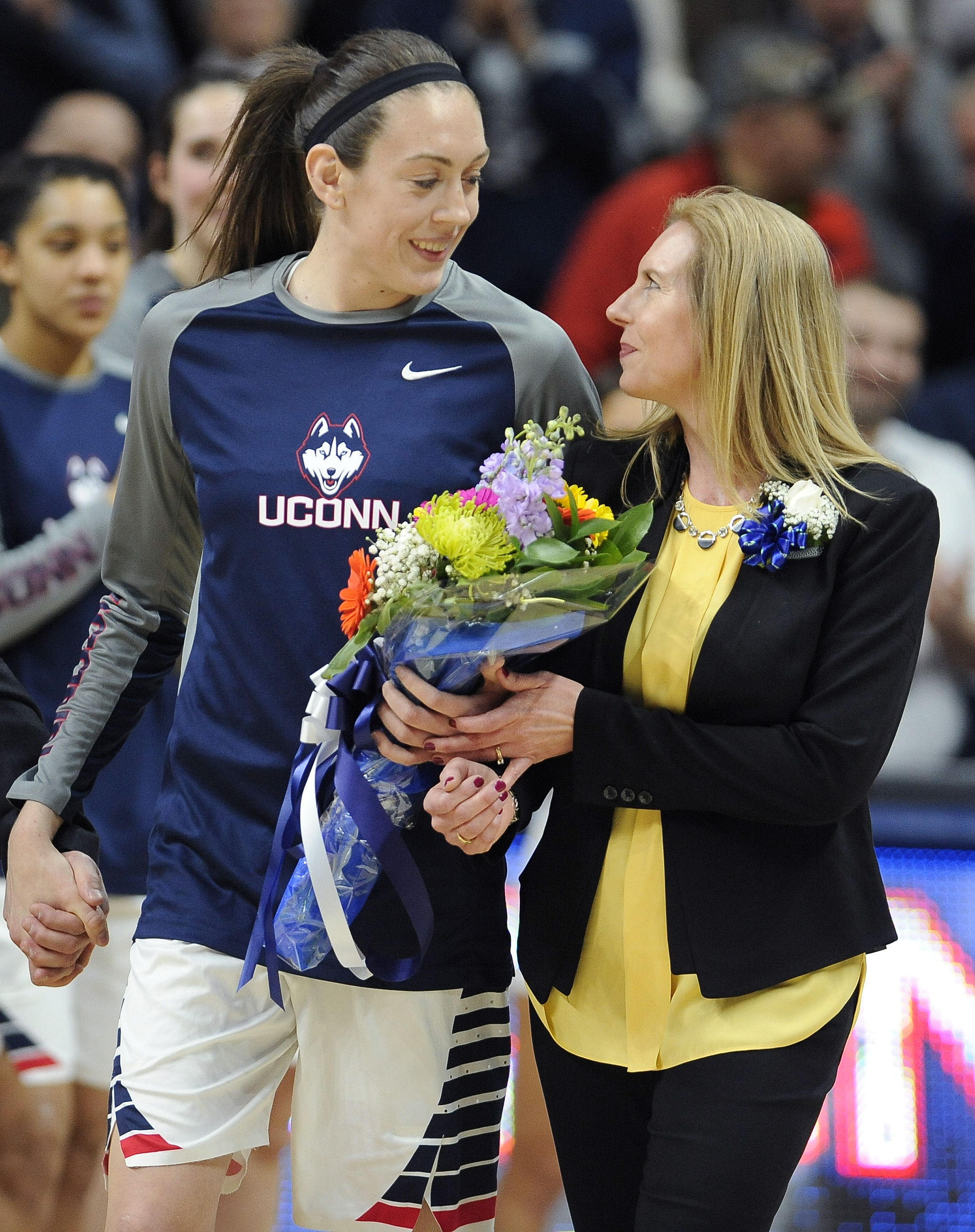 Connecticut's Breanna Stewart looks to her mother Heather Stewart as she is introduced during senior day ceremonies prior to an NCAA college basketball game against Tulane, Saturday, Feb. 27, 2016, in Storrs, Conn. (AP Photo/Jessica Hill)
