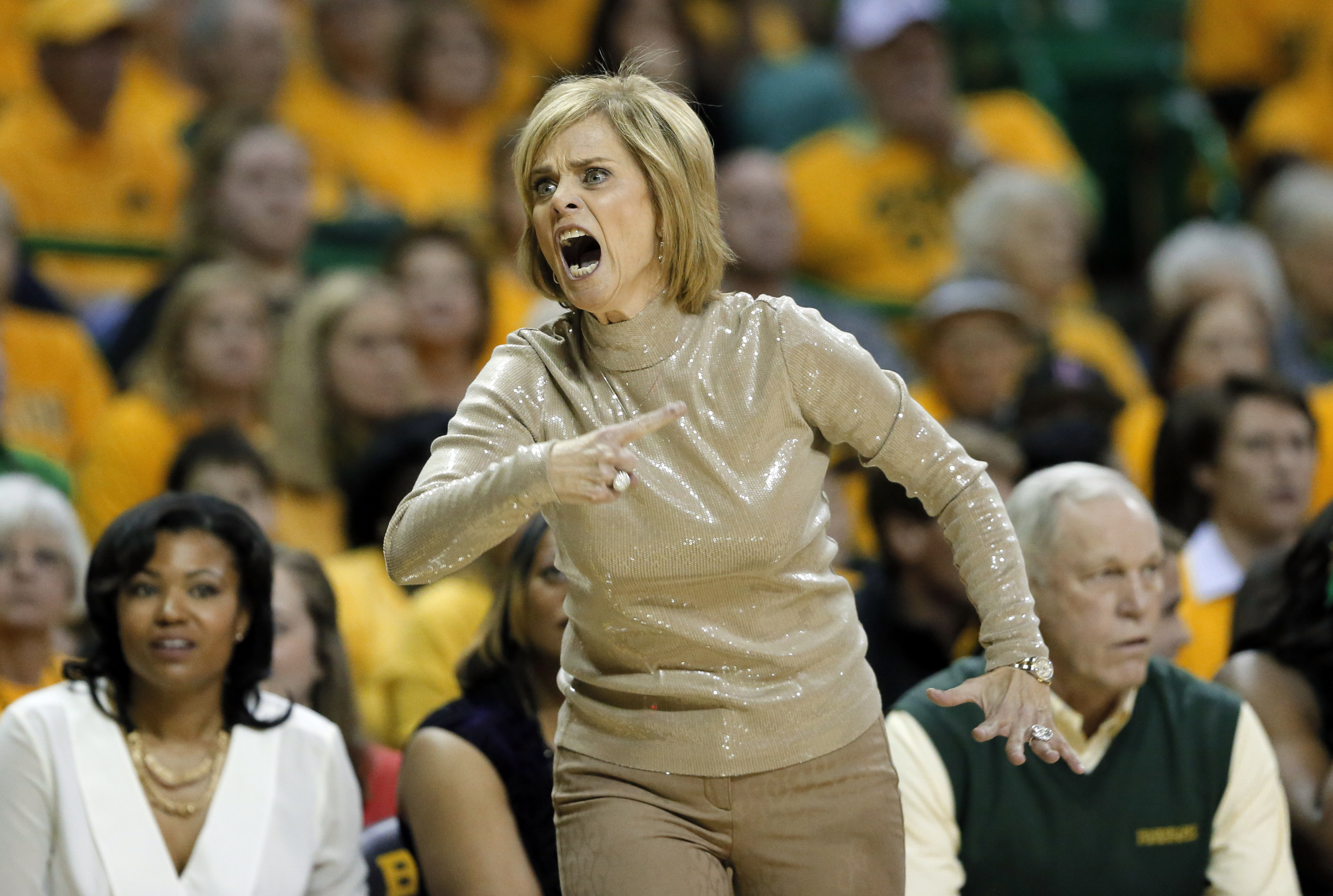 Baylor head coach Kim Mulkey looks for a foul call against Texas in the first half of an NCAA college basketball game, Monday, Feb. 29, 2016, in Waco, Texas. (AP Photo/Tony Gutierrez)