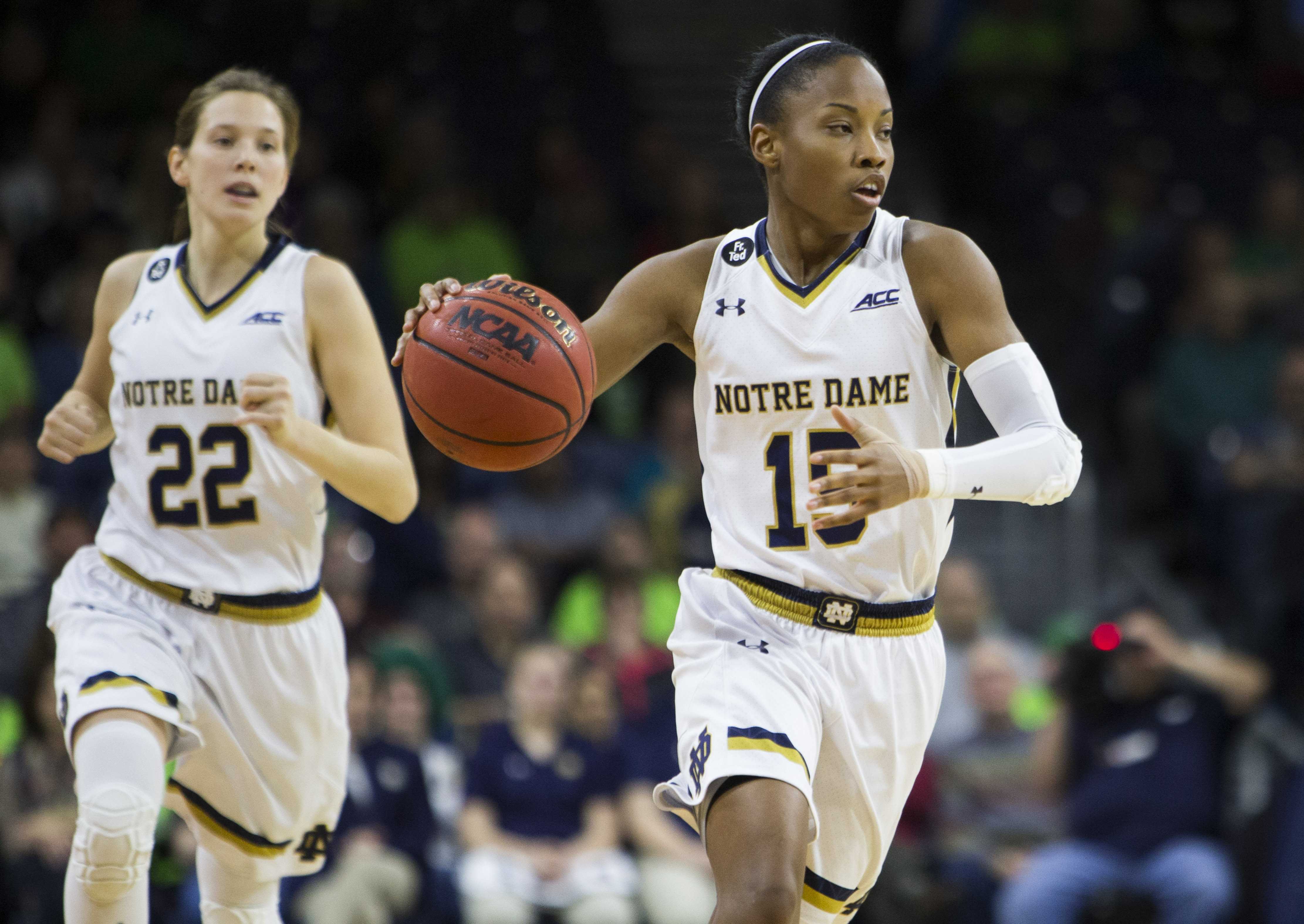FILE - In this Feb. 27, 2016, file photo, Notre Dame's Lindsay Allen (15) brings the ball downcourt in front of teammate Madison Cable (22) during Notre Dame's 70-58 win against Boston College in an NCAA college basketball game, in South Bend, Ind. The tw