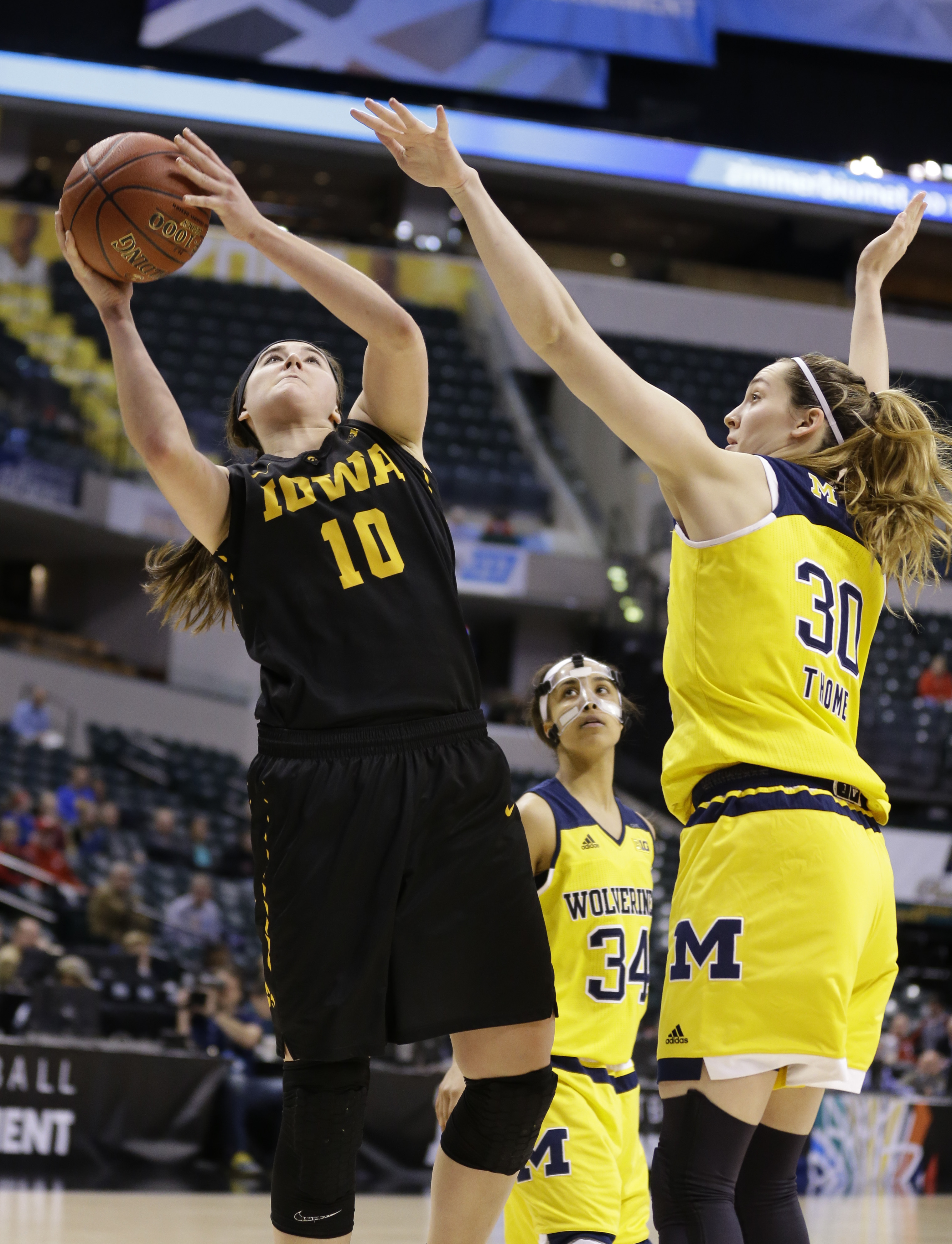 Iowa's Megan Gustafson (10) shoots over Michigan center Hallie Thome (30) in the second half of an NCAA college basketball game at the Big Ten Conference tournament in Indianapolis, Thursday, March 3, 2016. Iowa defeated Michigan 97-85. (AP Photo/Michael