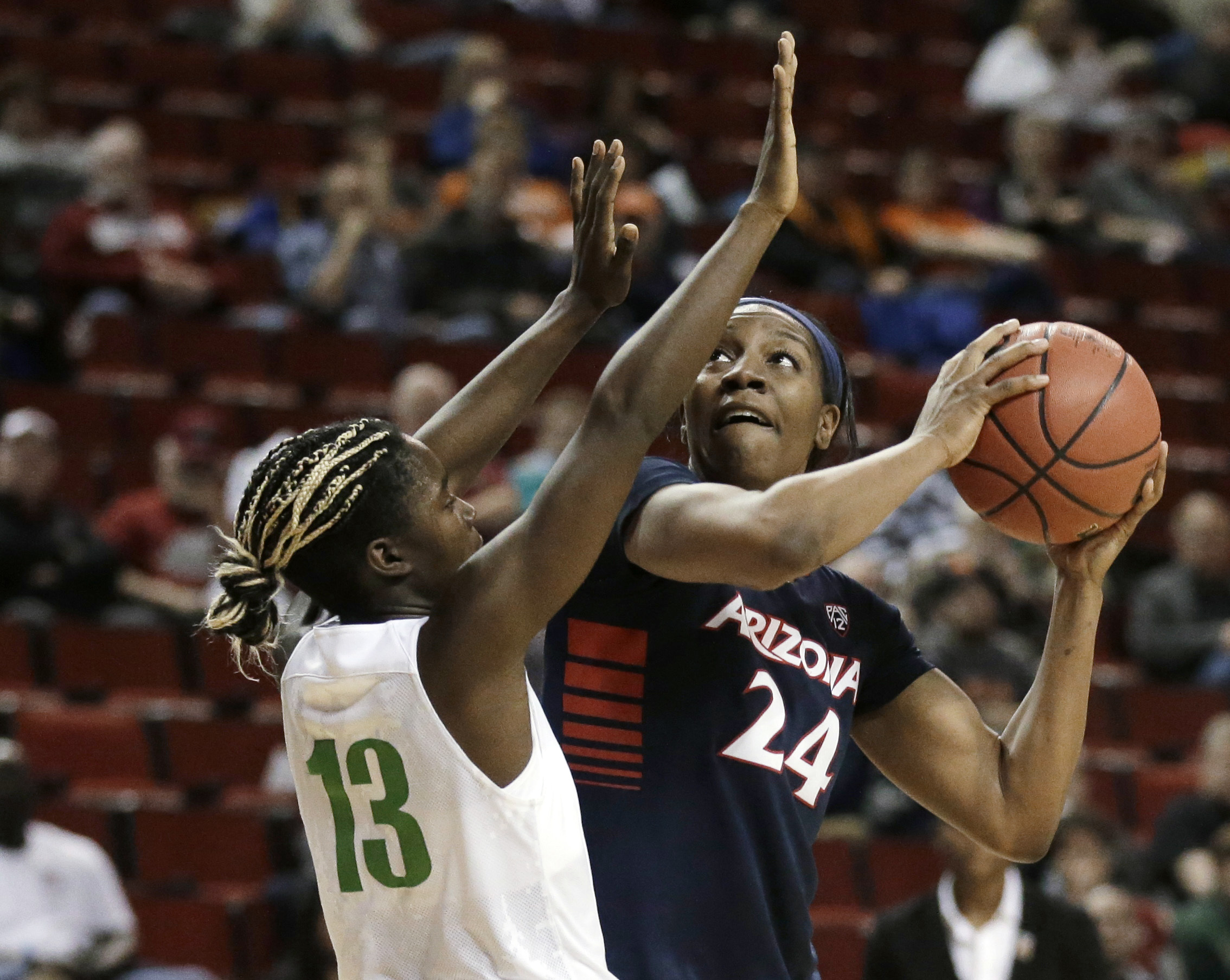 Arizona forward LaBrittney Jones (24) looks for a shot against Oregon guard Mar'Shay Moore (13) during the second half of an NCAA college basketball game in the Pac-12 women's tournament, Thursday, March 3, 2016, in Seattle. Arizona won 74-68. (AP Photo/T
