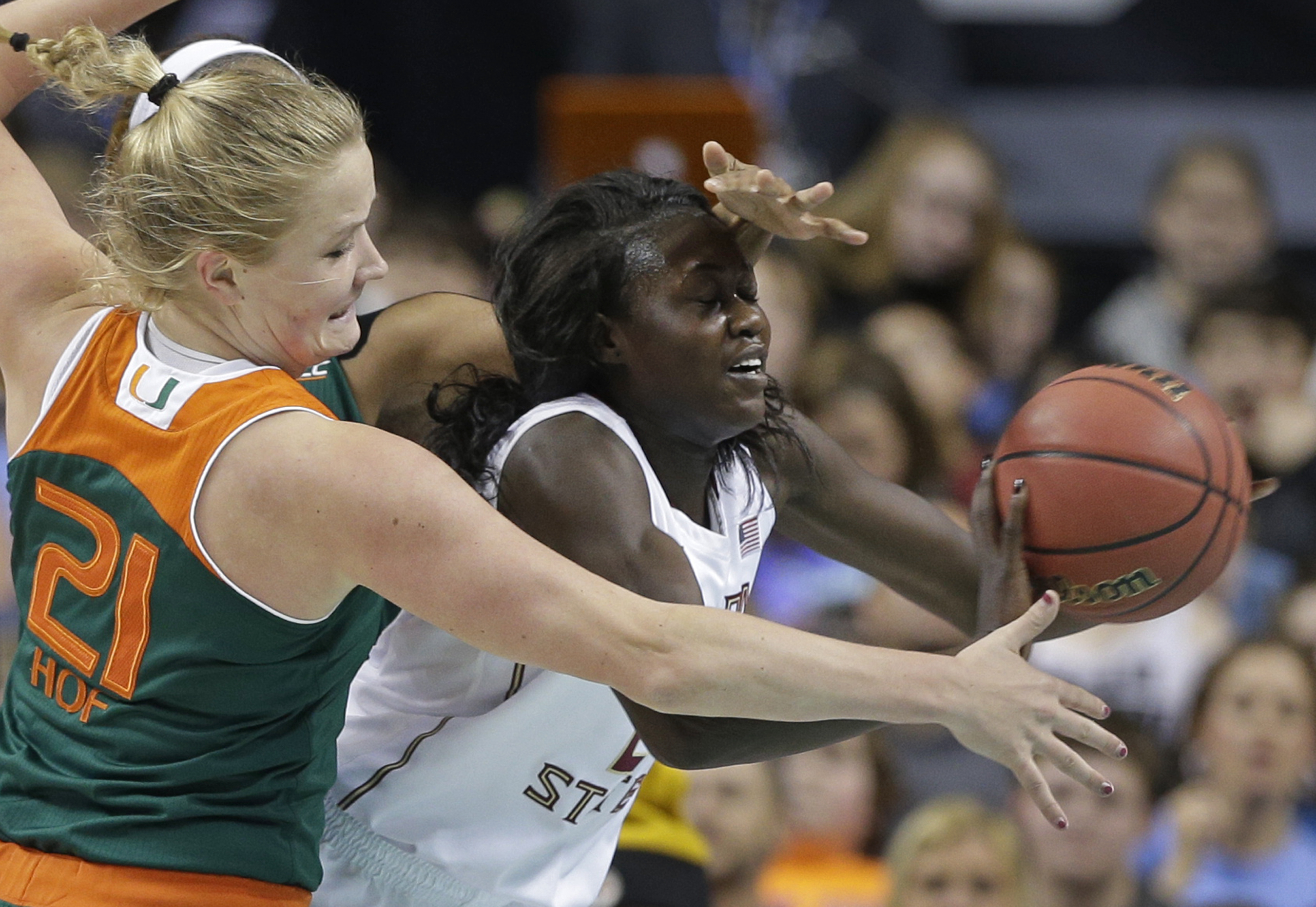 Florida State's Adut Bulgak, right, catches a ball as Miami's Emese Hof, left, of the Netherlands, defends in the first half of an NCAA women's Atlantic Coast Conference basketball game in Greensboro, N.C., Friday, March 4, 2016. (AP Photo/Chuck Burton)