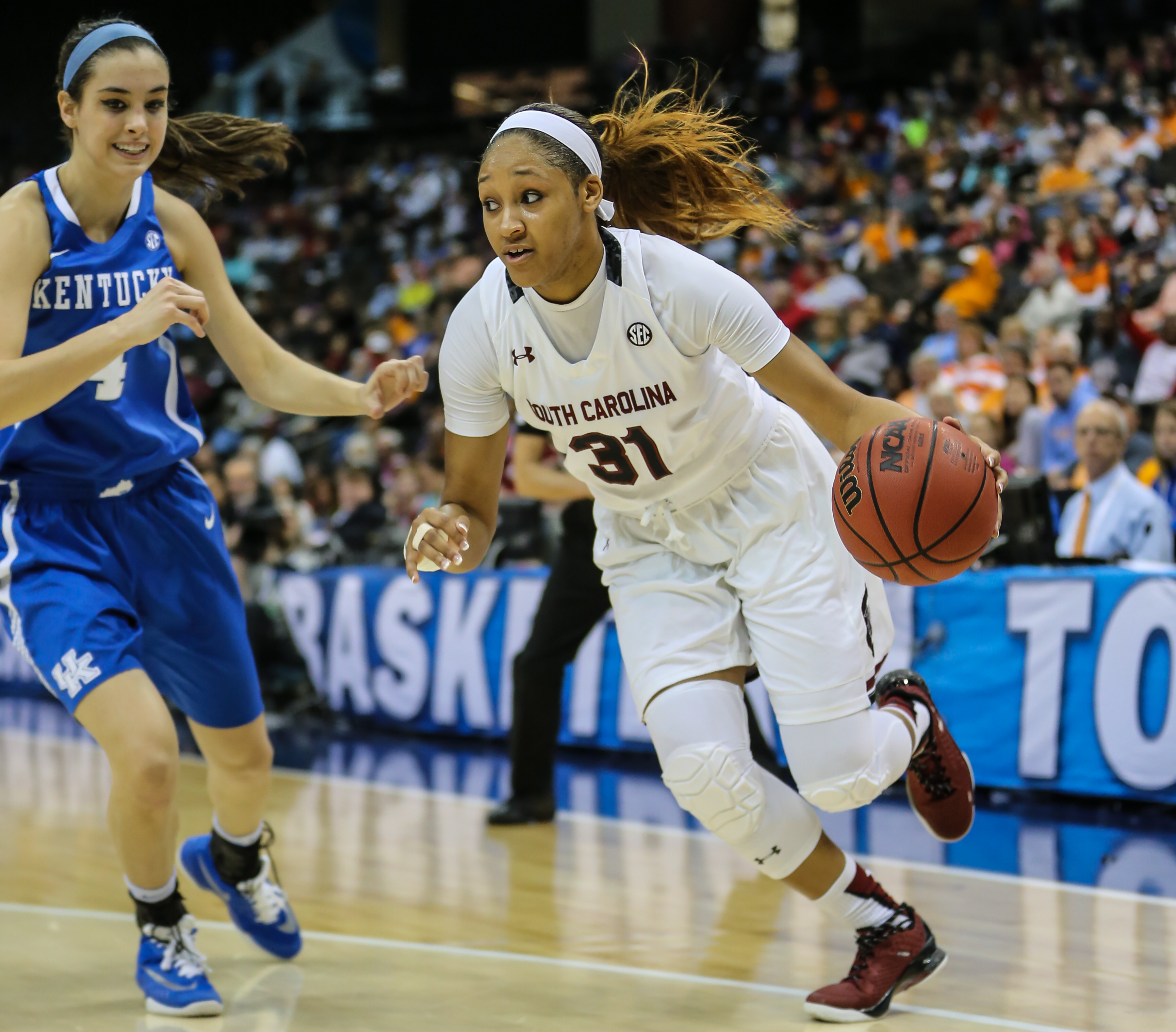 South Carolina forward Asia Dozier (31) drives to the basket defended by Kentucky forward Maci Morris (4) during an NCAA college basketball game in the Southeastern Conference women's tournament semifinal in Jacksonville, Fla., Saturday, March 5, 2016. (A