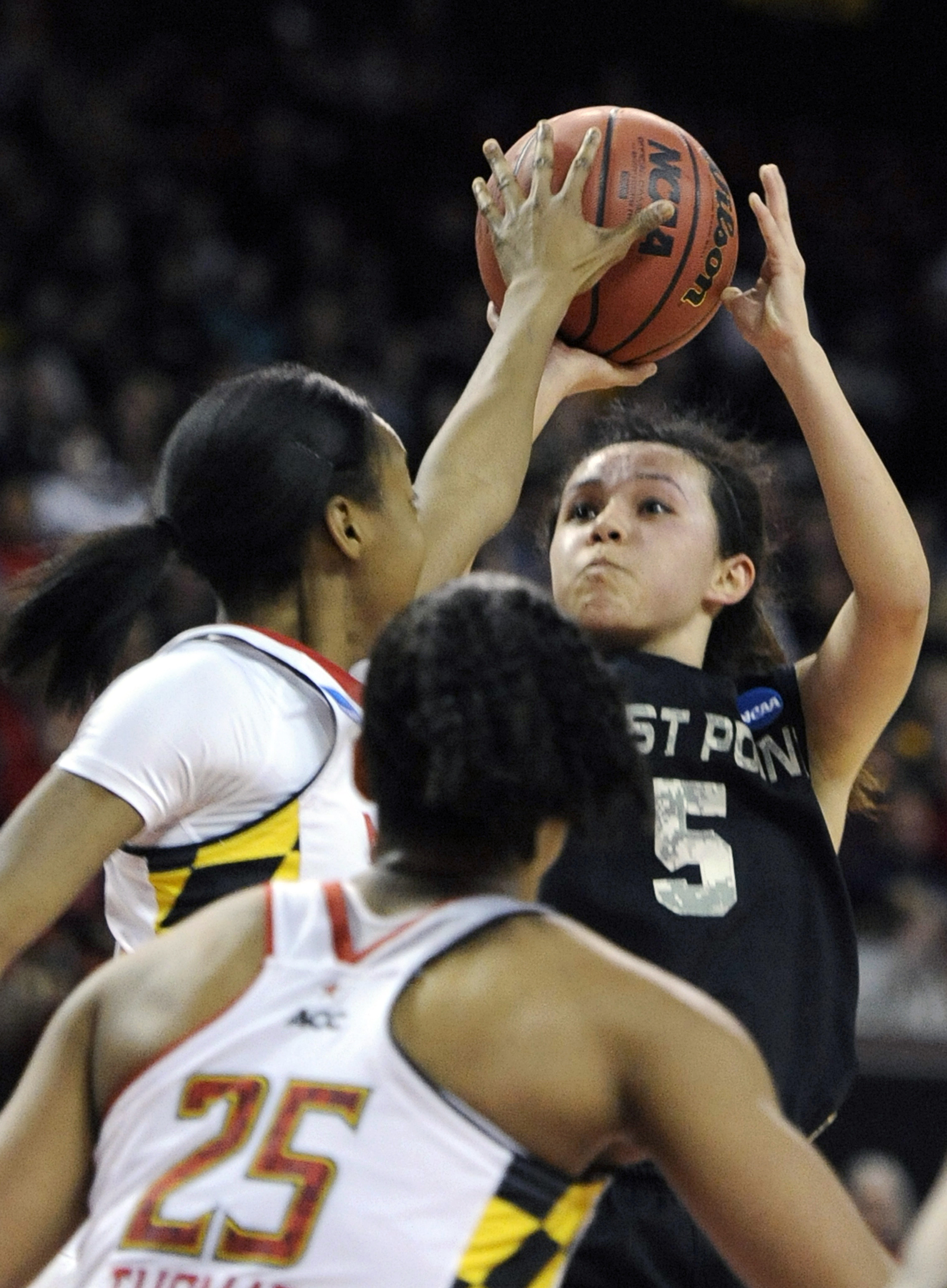 FILE - In this March 23, 2014, file photo, Army's Kelsey Minato (5) shoots over Maryland's Shatori Walker-KImbrough during the first half of the first round of the NCAA women's college basketball tournament in College Park, Md. Minato has accomplished wha