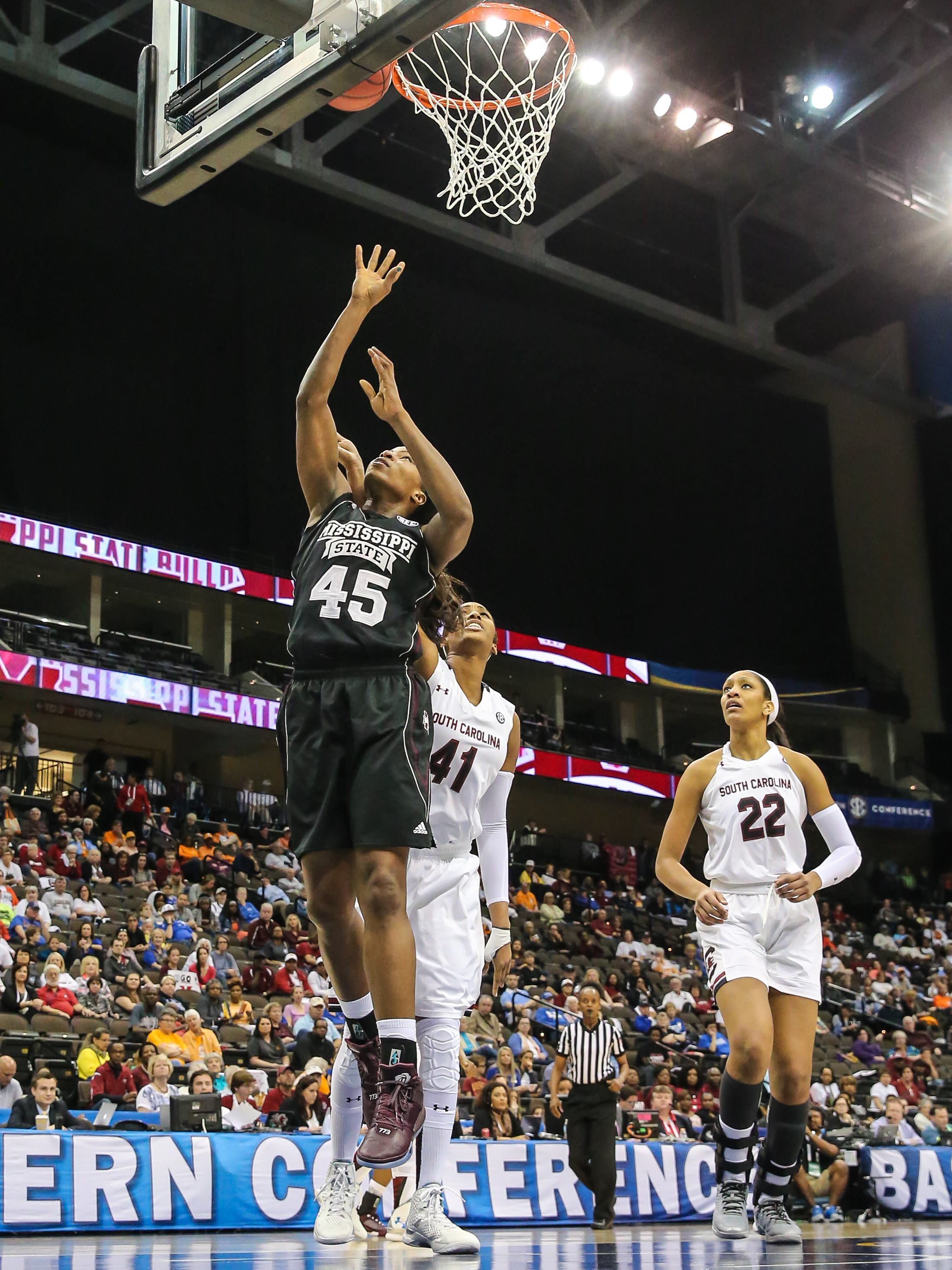 Mississippi State center Chinwe Okorie (45) lays the ball to the basket in front of South Carolina center Alaina Coates (41) and forward A'ja Wilson (22) during NCAA college basketball action in the Southeastern Conference women's tournament final in Jack