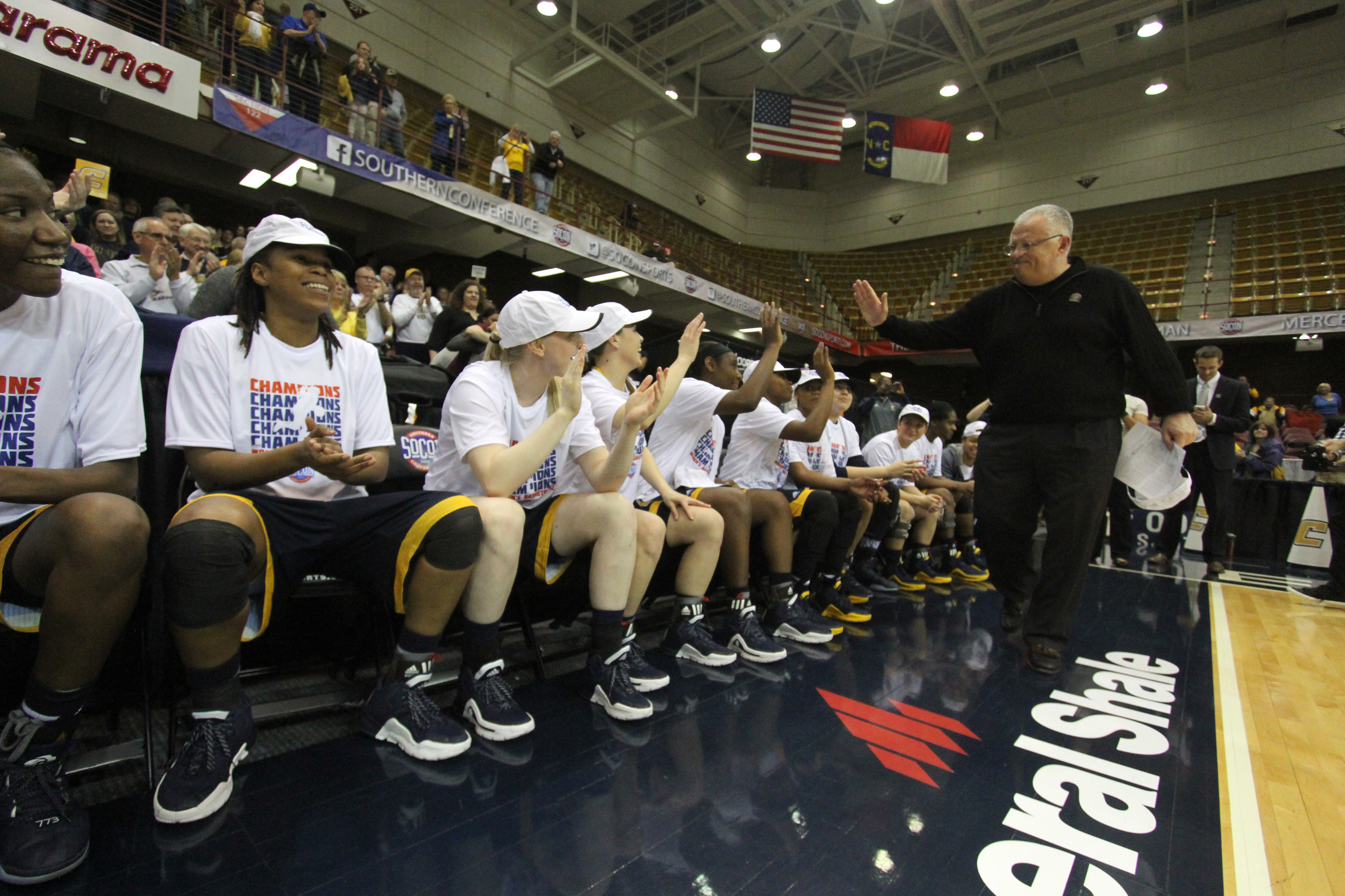 Chattanooga's women's basketball team celebrates after their 65-57 victory over Mercer in the championship game of the NCAA women's Southern Conference basketball tournament in Asheville, N.C., Sunday, March 6, 2016. (AP Photo/Ben Earp)