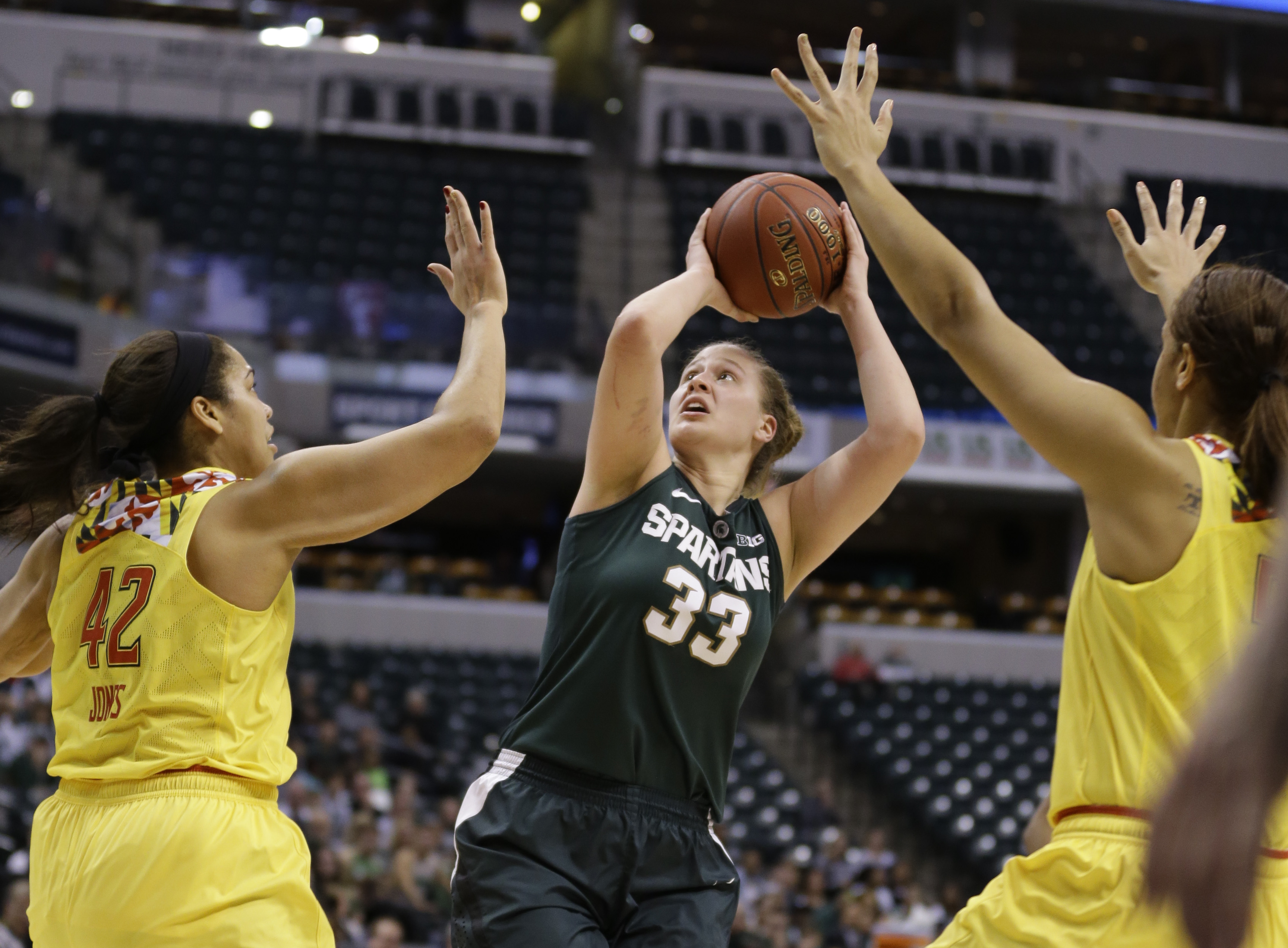 Michigan State center Jenna Allen (33) shoots between Maryland center Brionna Jones (42) and center Malina Howard (5) in the first half of an NCAA college basketball game in the finals of the Big Ten Conference tournament in Indianapolis, Sunday, March 6,