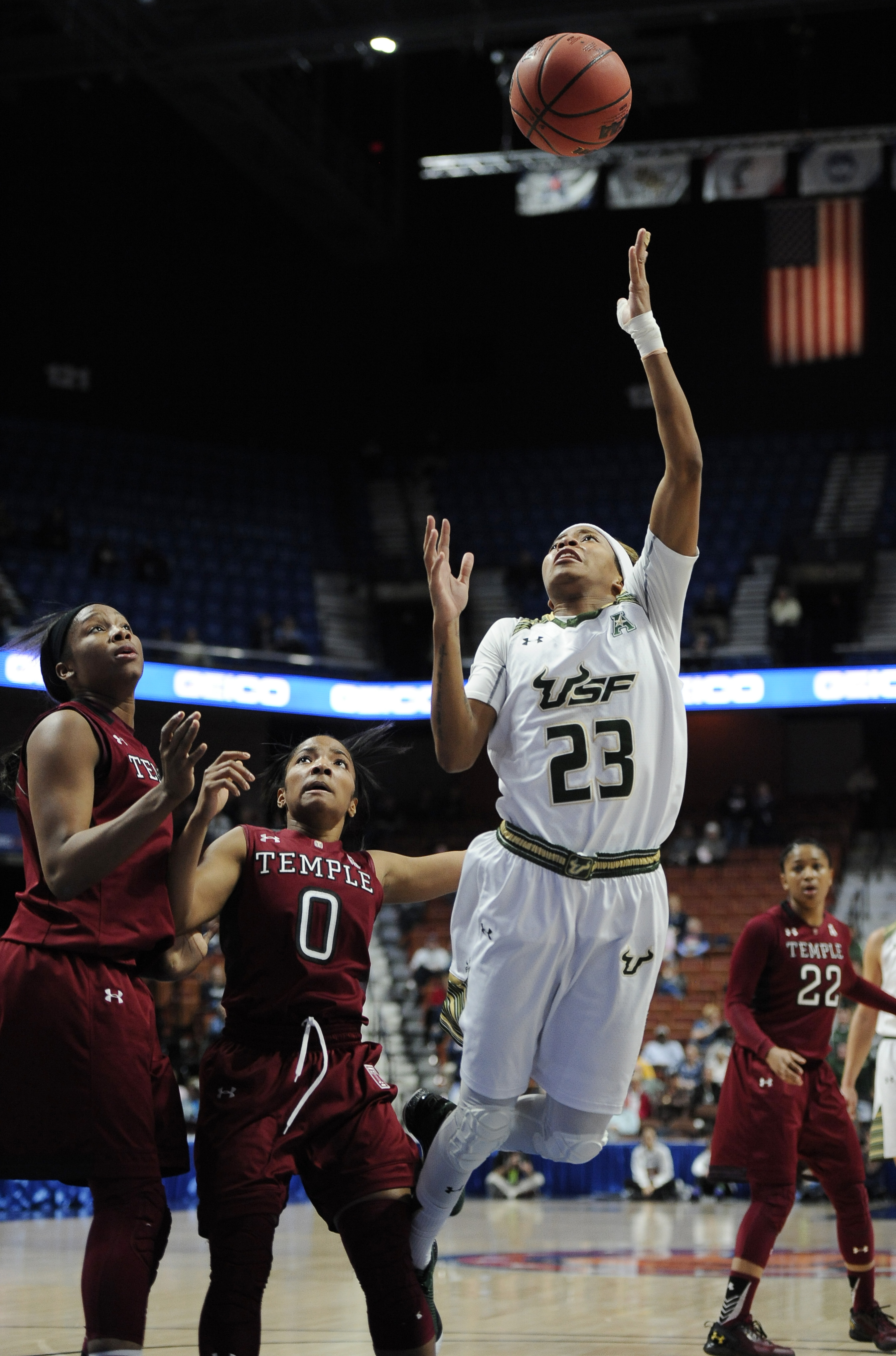 South Florida's Shalethia Stringfield shoots over Temple's Erica Covile, left, and Alliya Butts, center, during the first half of an NCAA college basketball game in the American Athletic Conference tournament semifinals at Mohegan Sun Arena, Sunday, March