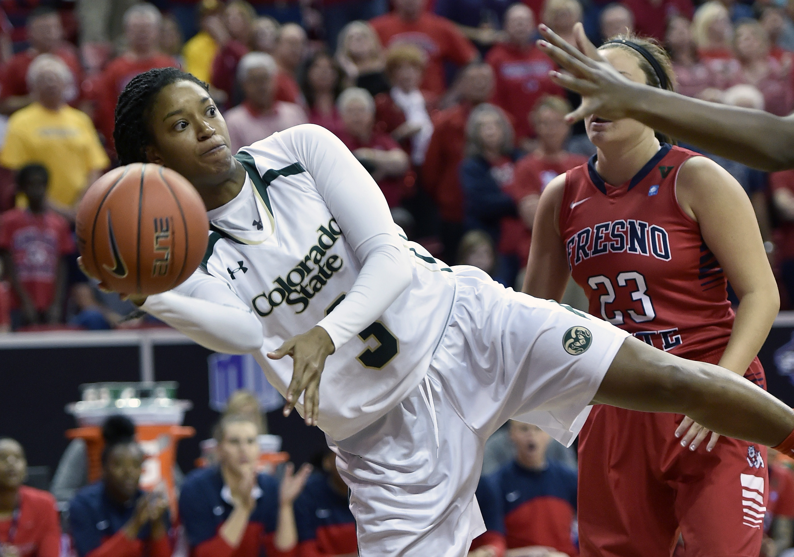 Colorado State's Keyora Wharry (3) looks to pass against Fresno State during the first half during the championship game at the NCAA Mountain West Conference women's tournament Friday, March 11, 2016, in Las Vegas. (AP Photo/David Becker)