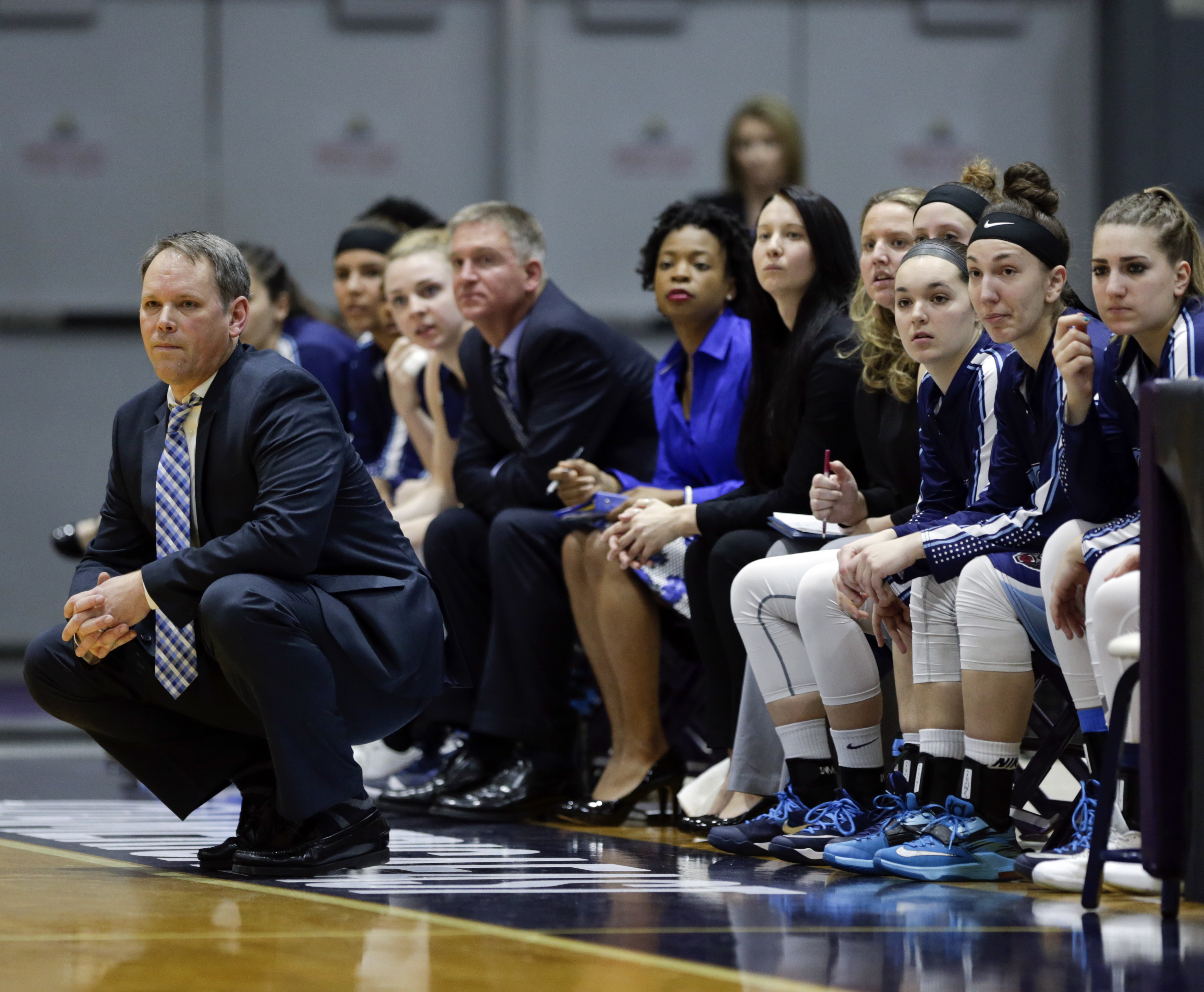 Maine head coach Richard Barron, left, watches the first half an NCAA women's college basketball game against Albany in the America East Conference tournament championship on Friday, March 11, 2016, in Albany, N.Y. (AP Photo/Mike Groll)