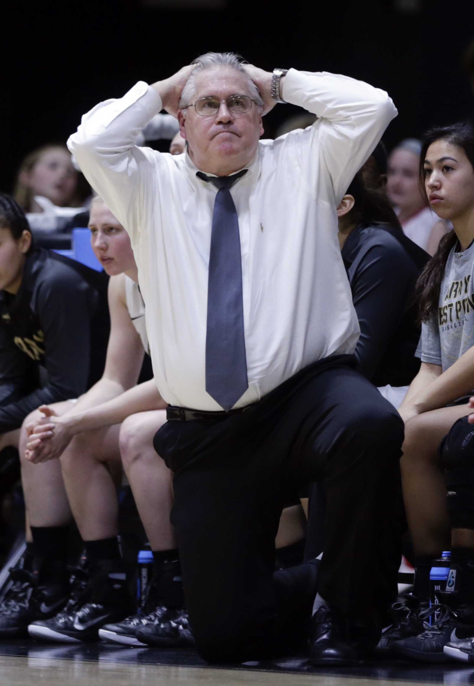 Army head coach Dave Magarity watches action from the bench during the first half an NCAA women's college basketball game against Loyola (Md.) in the Patriot League tournament championship on Saturday, March 12, 2016, in West Point, N.Y. (AP Photo/Mike Gr