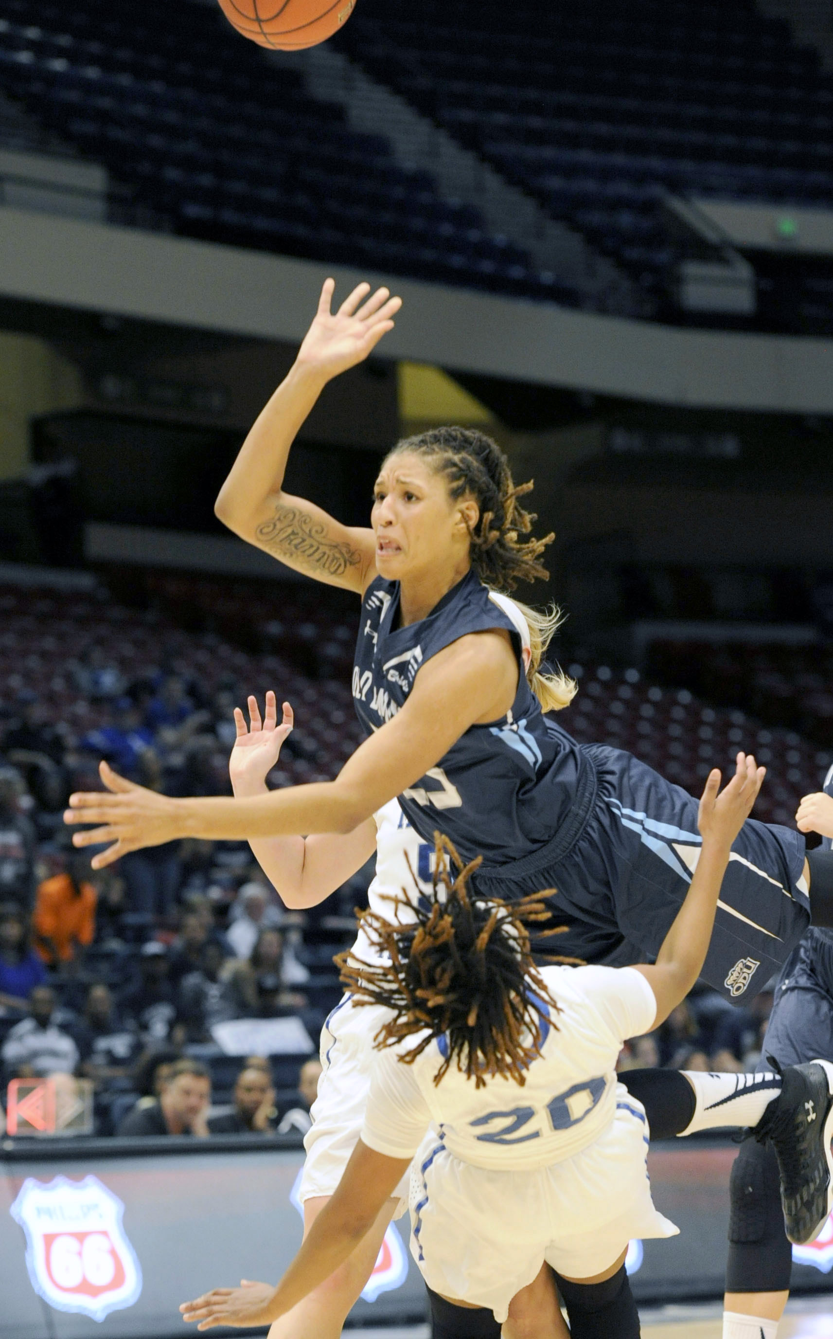 Old Dominion's Jennie Simms (25) jumps over Middle Tennessee's Ty Petty (20) during the first half of the NCAA women's college basketball game in the championship of the Conference USA men's tournament Saturday, March 12, 2016, in Birmingham, Ala. (AP Pho