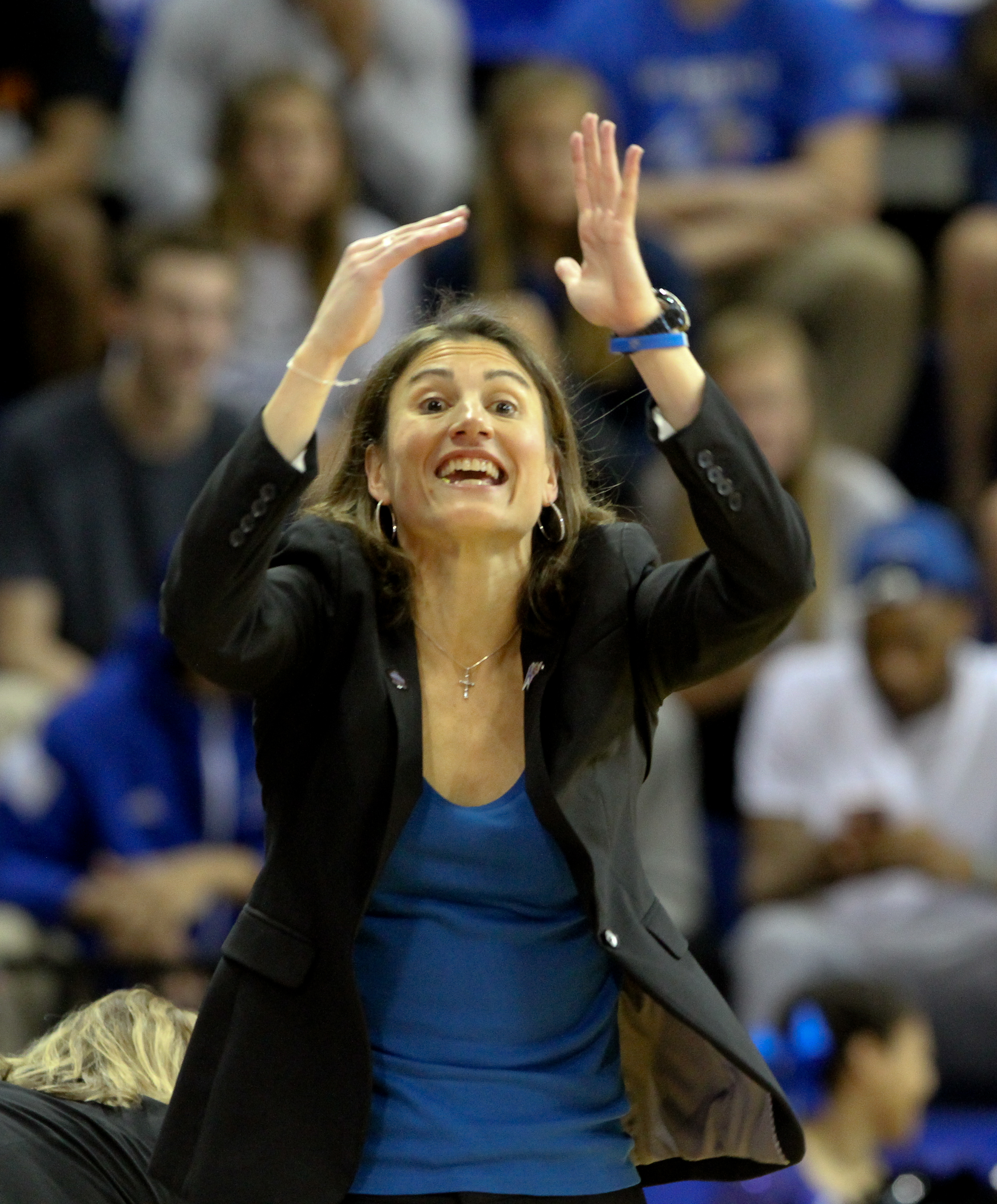 UNC Asheville's head coach Brenda Mock Kirkpatrick yells out a play during the first half of the championship game of the NCAA women's Big South college basketball tournament in Asheville, N.C., Sunday, March 13, 2016. (AP Photo/Ben Earp)