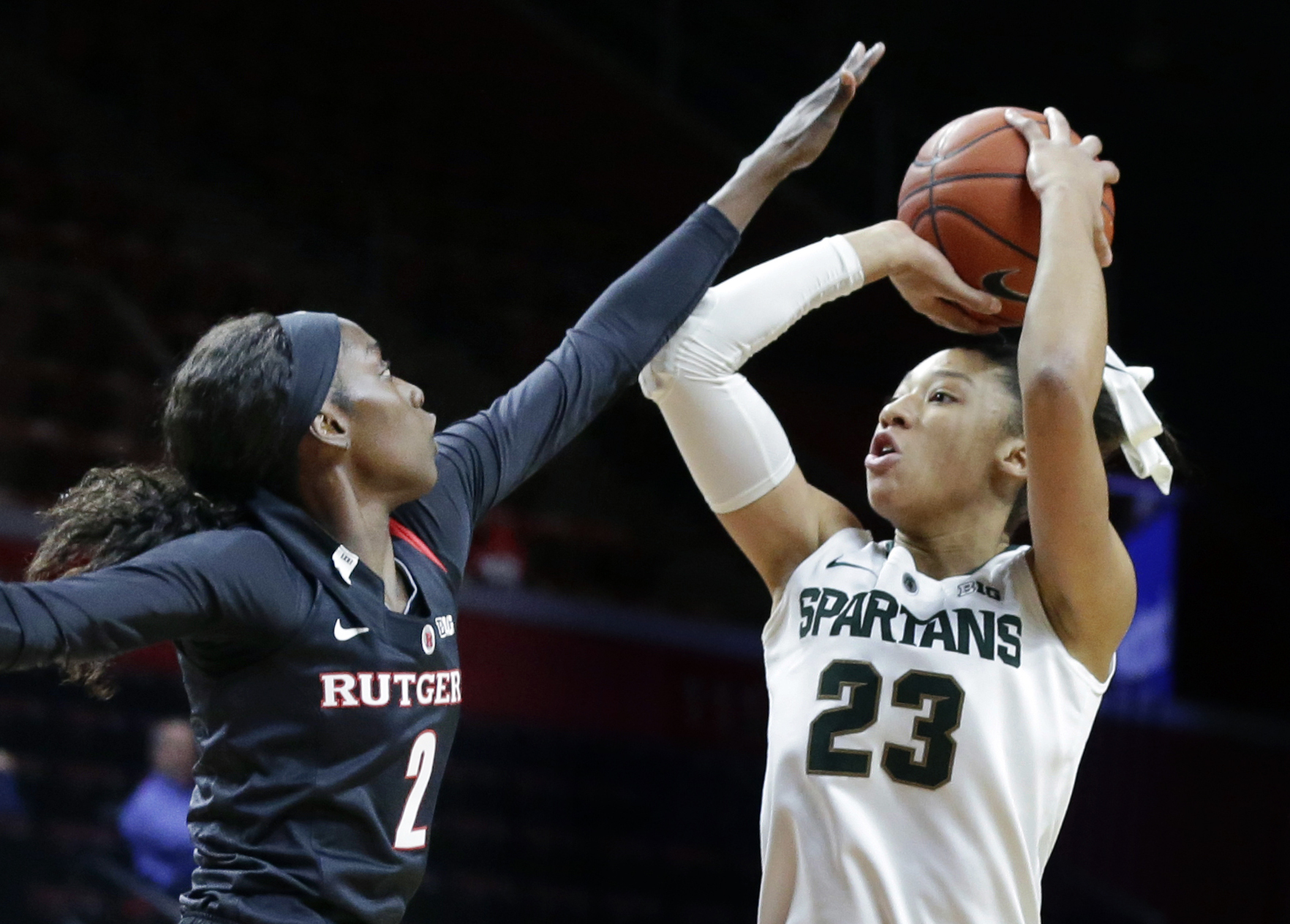 FILE - In this Feb. 18, 2016, file photo, Michigan State forward Aerial Powers (23) shoots over Rutgers forward Kahleah Copper (2) during the first half of an NCAA college basketball game in Piscataway, N.J. Powers leads fourth-seeded Michigan State into