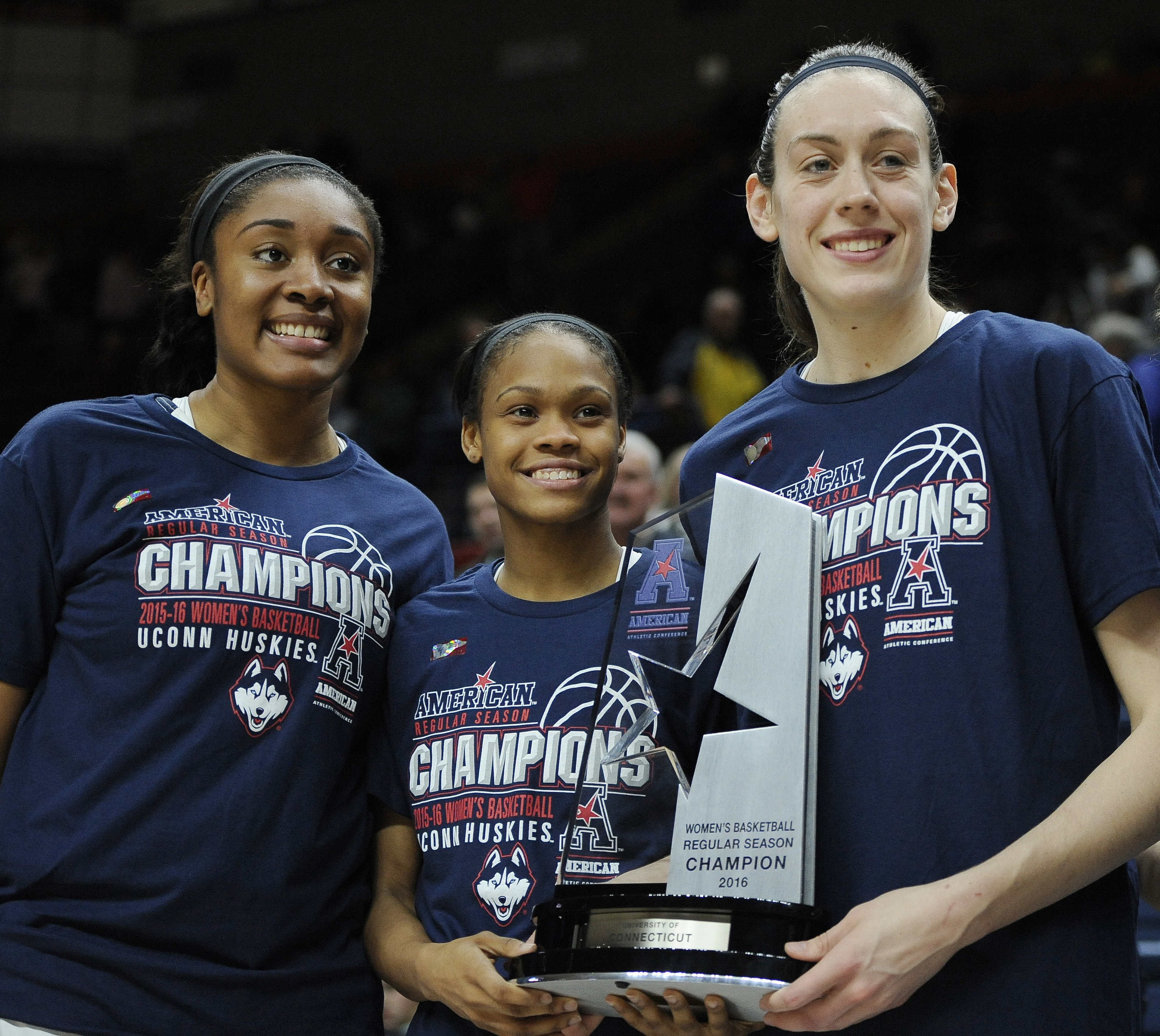 FILE - In this Feb. 24, 2016, file photo, Connecticut seniors, from left, Morgan Tuck, Moriah Jefferson and Breanna Stewart pose with American Athletic Conference regular season championsh trophy after their 88-41 win over SMU in an NCAA college basketbal