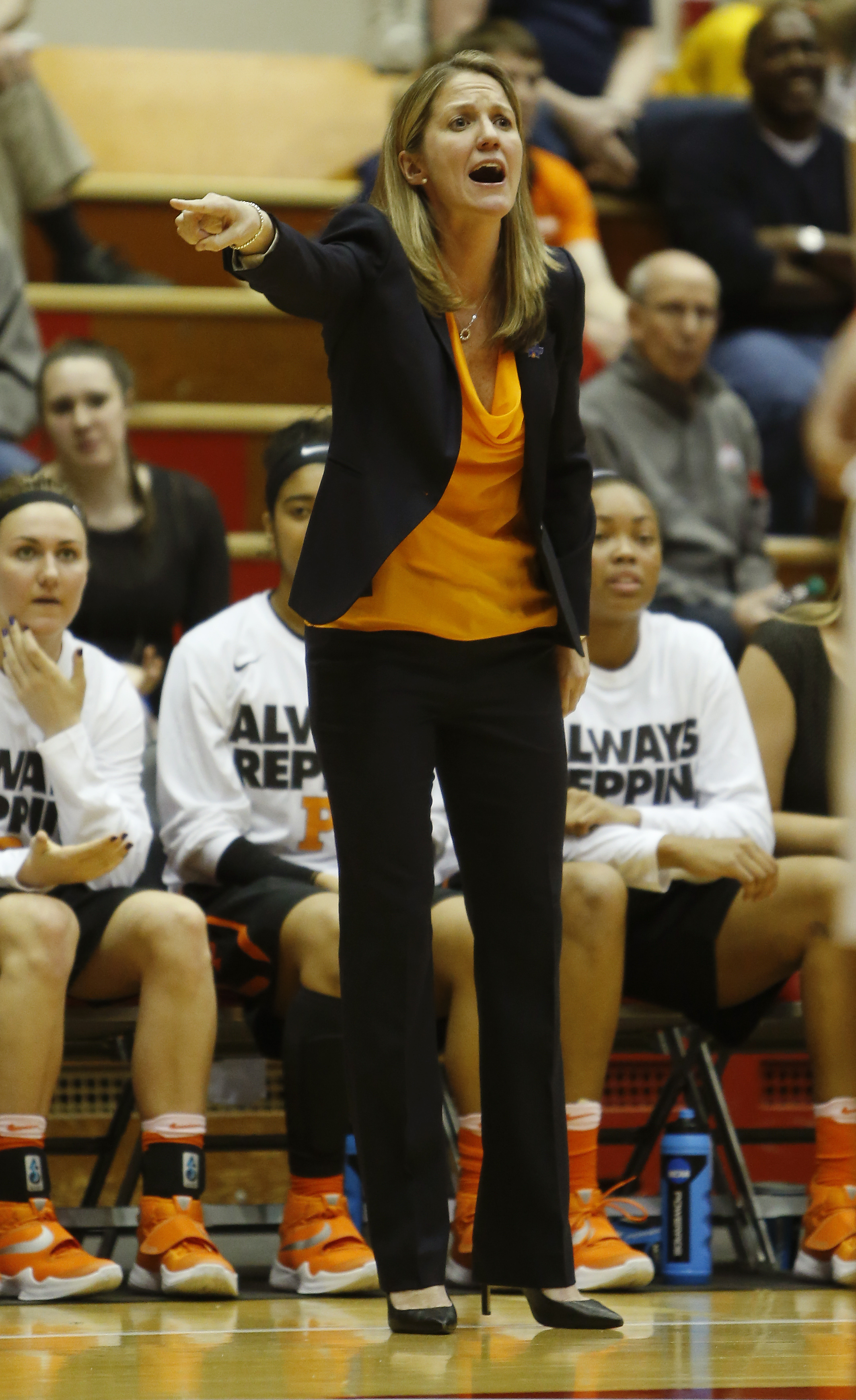 Princeton coach Courtney Banghart shouts to her team against West Virginia during a first-round women's college basketball game in the NCAA Tournament Friday, March 18, 2016, in Columbus, Ohio. West Virginia beat Princeton 74-65. (AP Photo/Jay LaPrete)