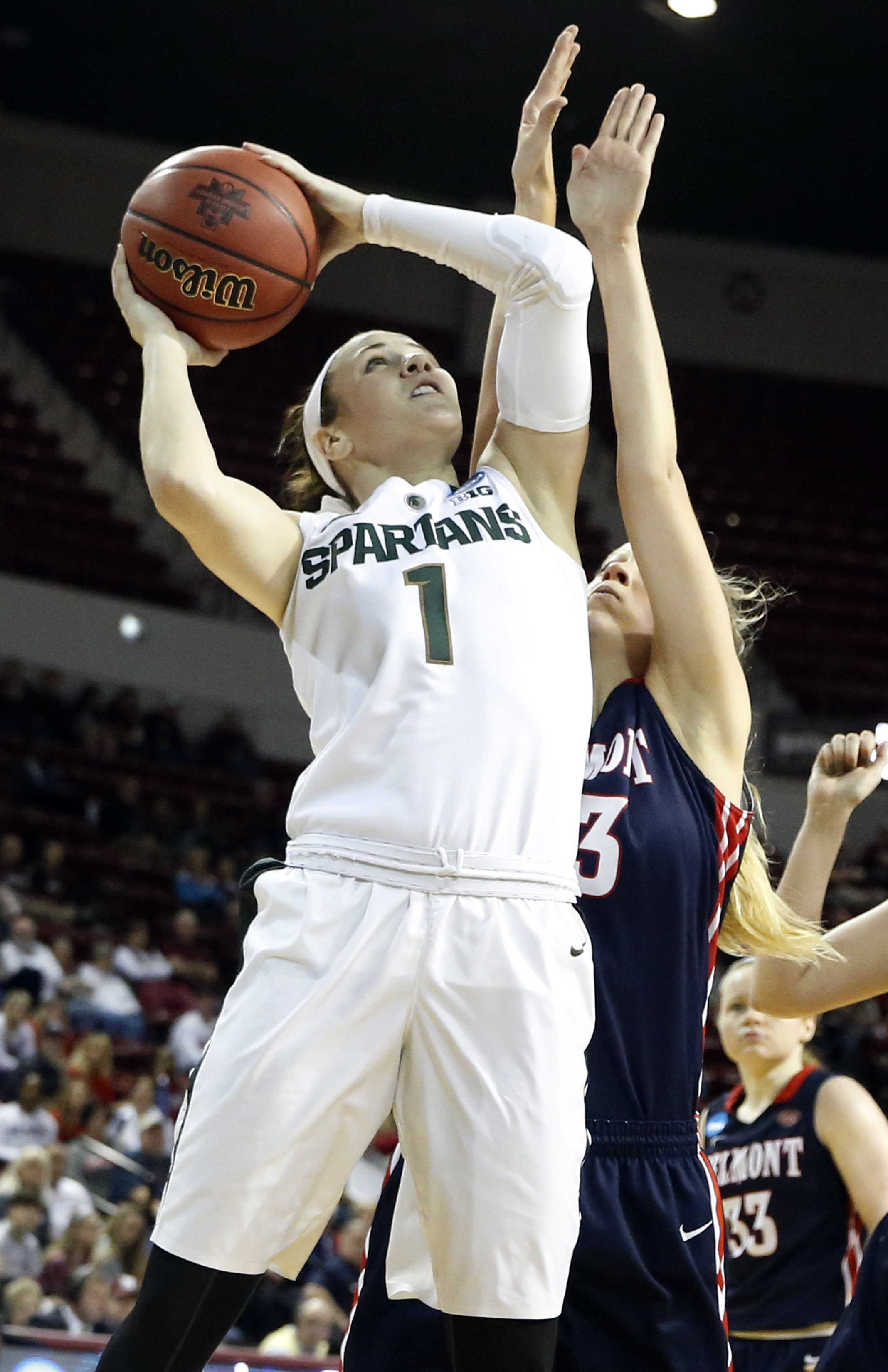 Michigan State guard Tori Jankoska (1) attempts a shot at the basket as a Belmont player defends during the second half in a first-round women's college basketball game in the NCAA Tournament, Friday, March 18, 2016, in Starkville, Miss. Michigan State wo