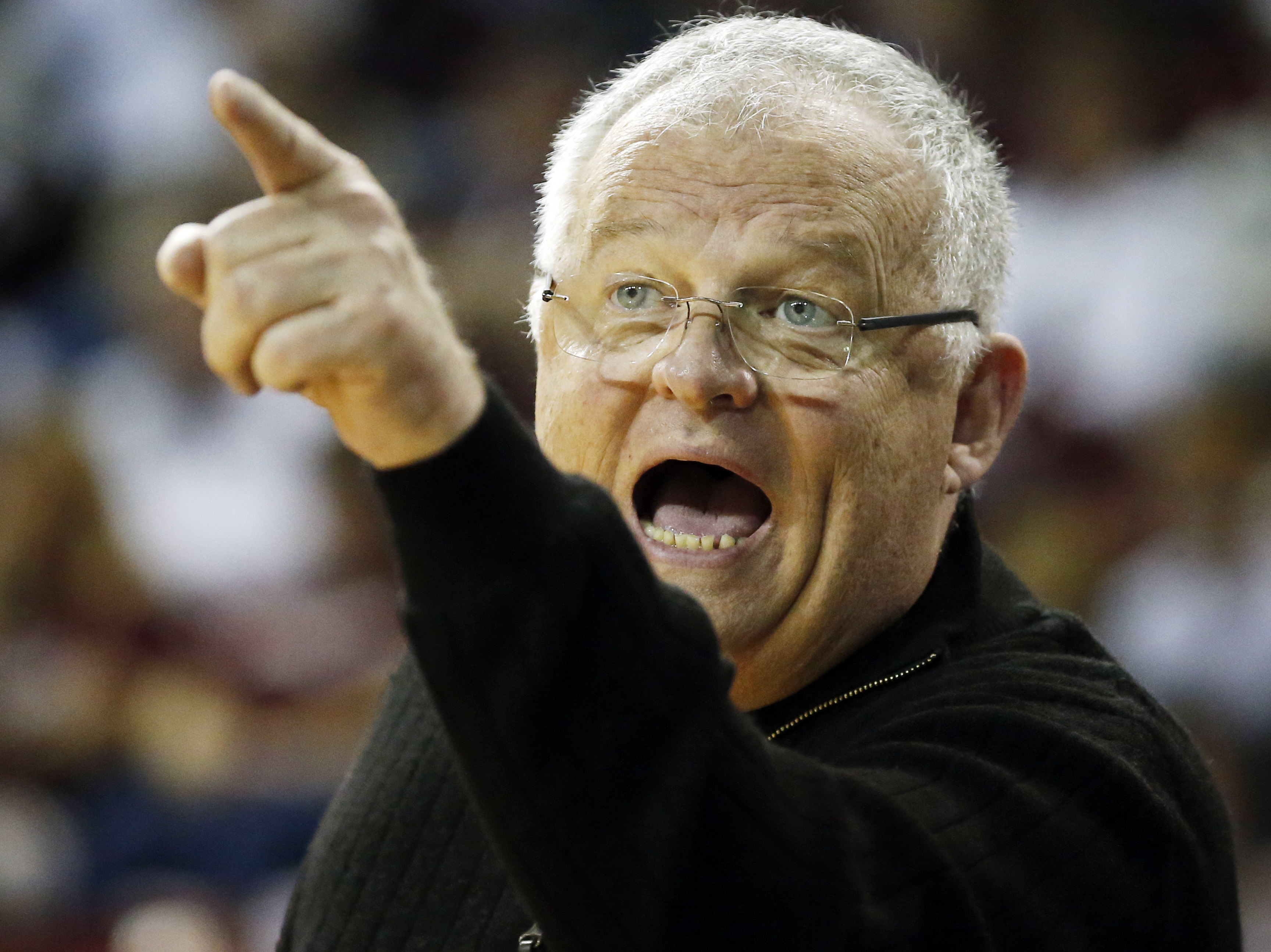 Chattanooga head coach Jim Foster calls out to the officials during the second half in a first-round women's college basketball game against Mississippi State in the NCAA Tournament, Friday, March 18, 2016, in Starkville, Miss. Mississippi State won 60-50