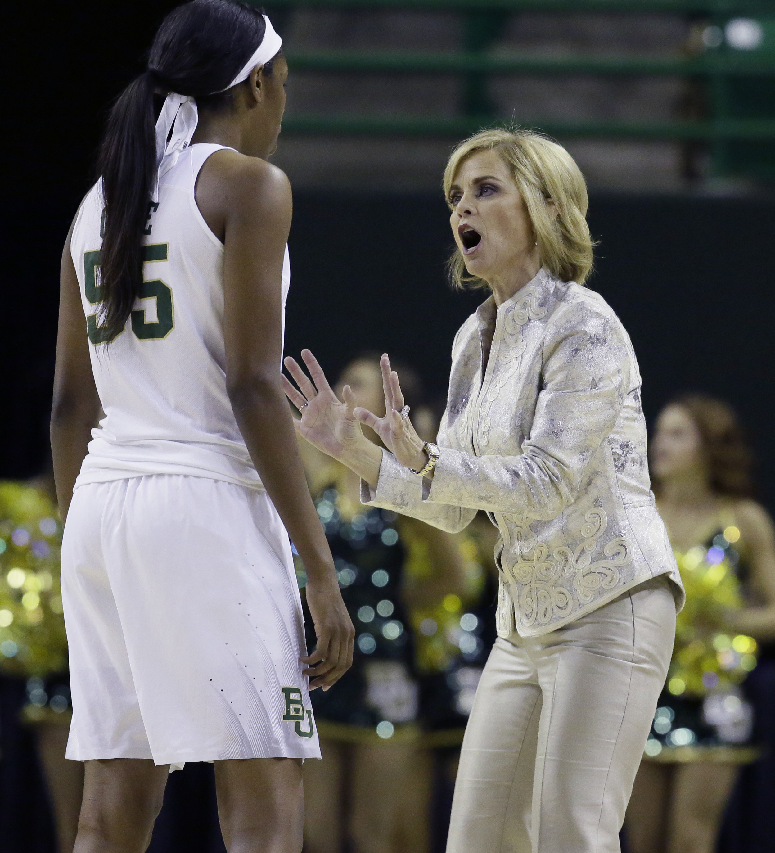 Baylor head coach Kim Mulkey, right, gives directions to center Khadijiah Cave (55) during the first half of a  first-round women's college basketball game against Idaho in the NCAA Tournament Friday, March 18, 2016, in Waco, Texas. (AP Photo/LM Otero)
