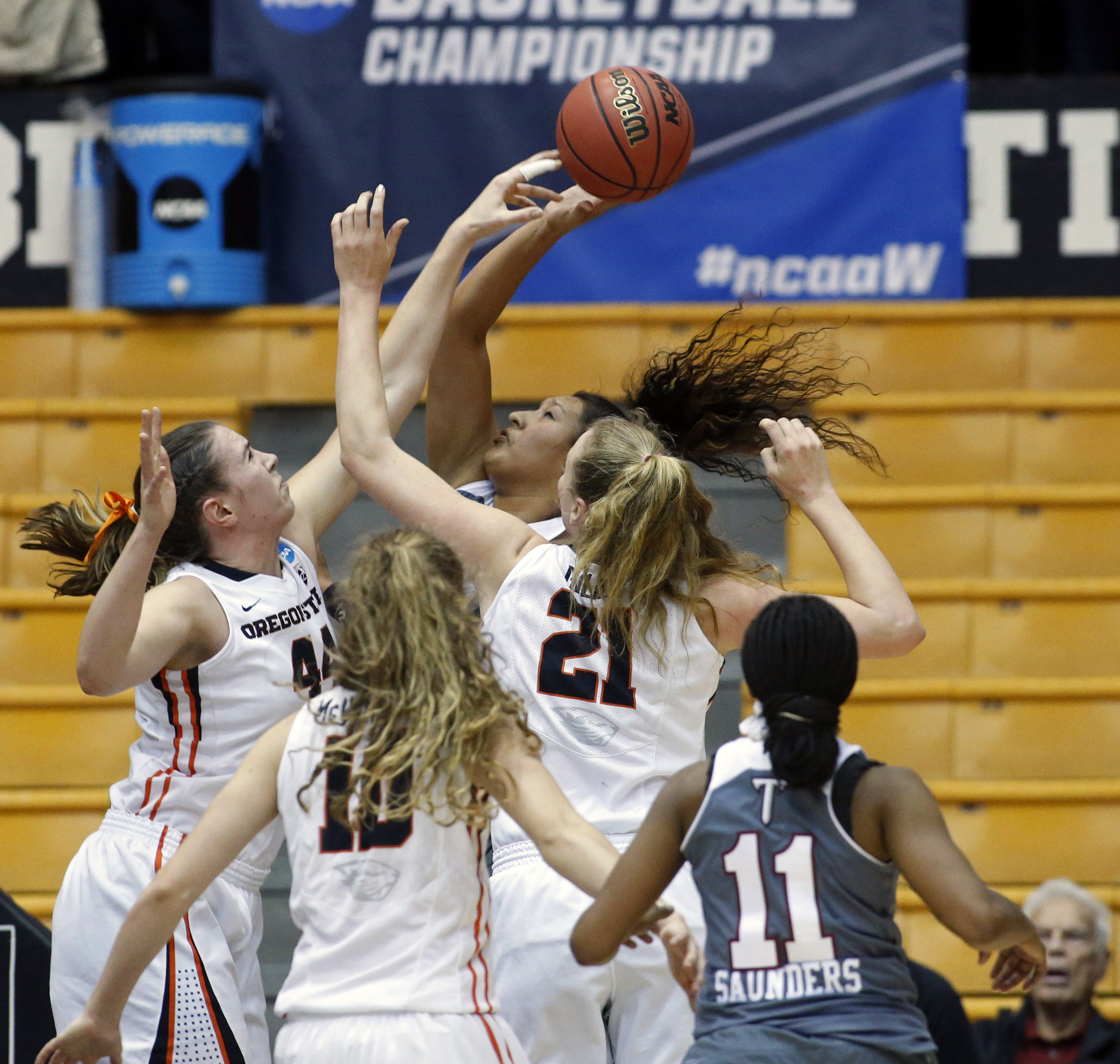 Oregon State' Ruth Hamblin, left, blocks the shot of Troy's Caitlyn Ramirez, center rear, in the first half of a game in the first round of a women's college basketball game in the NCAA Tournament in Corvallis, Ore., on Friday March 18, 2016 (AP Photo/Tim