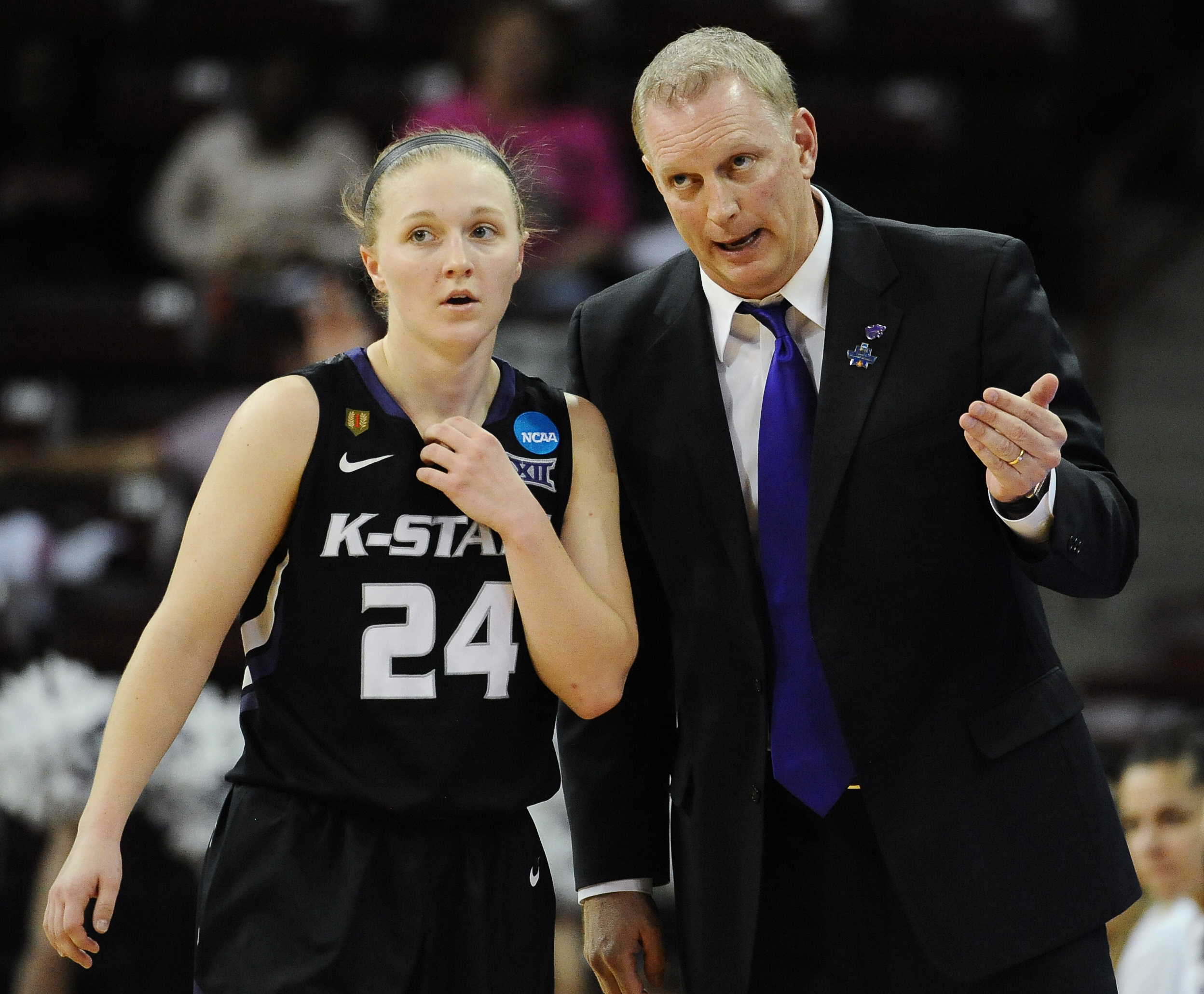 Kansas State head coach Jeff Mittie, right, talks with player Kindred Wesemann during a first-round women's college basketball game in the NCAA Tournament on Friday, March 18, 2016, in Columbia, S.C.  (AP Photo/Rainier Ehrhardt)