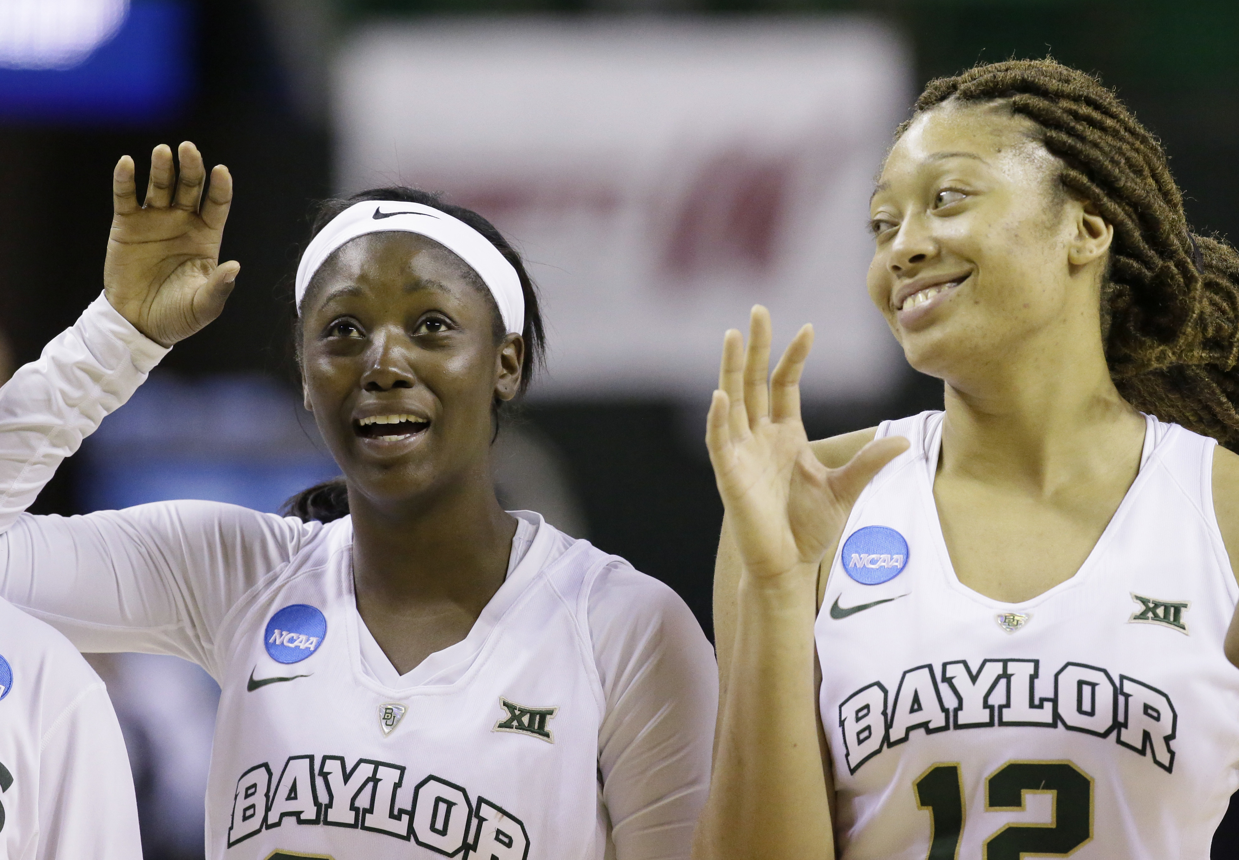 Baylor guards Alexis Jones, left, and Alexis Prince (12) celebrate after defeating Idaho in a first-round women's college basketball game in the NCAA Tournament Friday, March 18, 2016, in Waco, Texas.  (AP Photo/LM Otero)