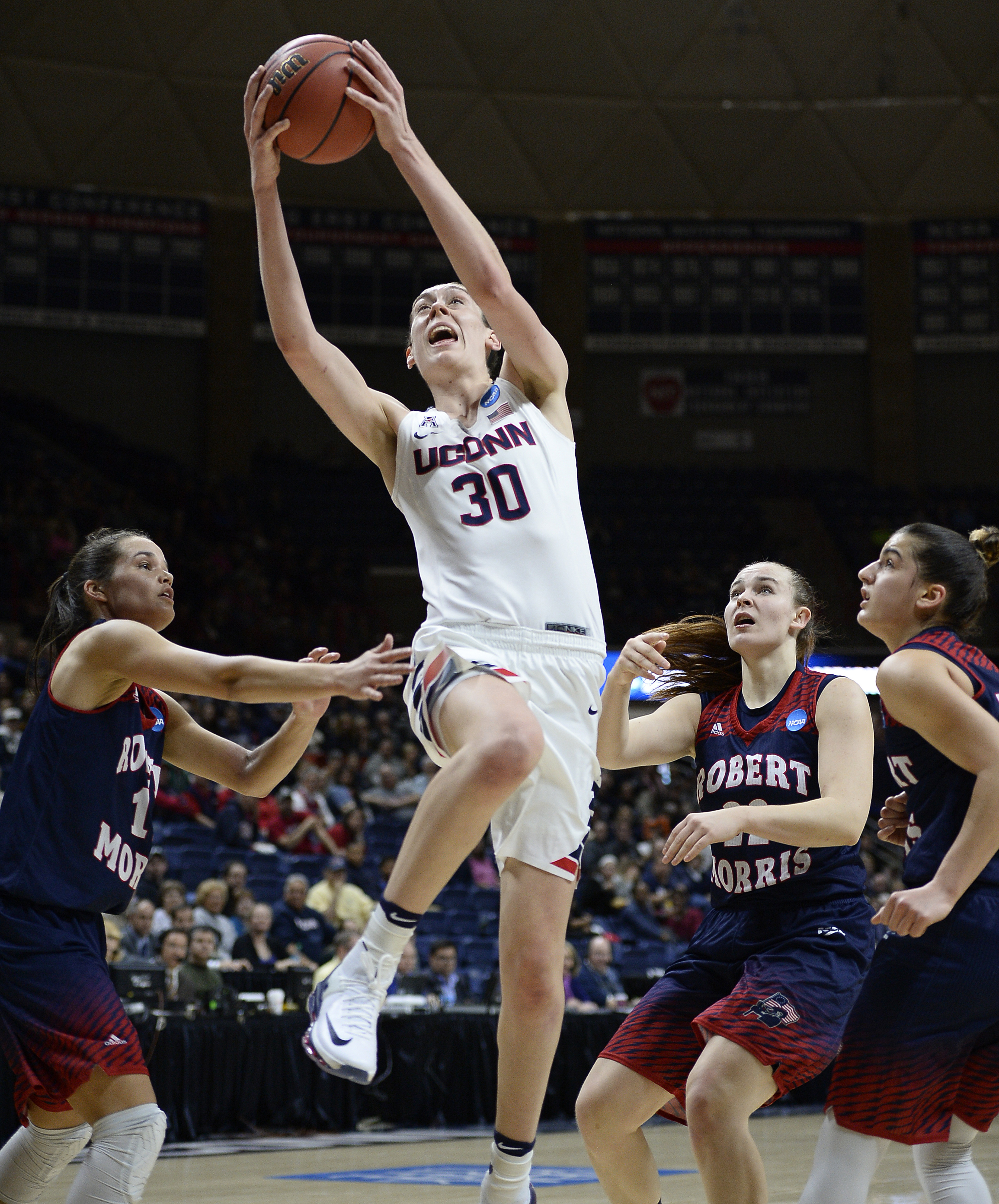Connecticuts Breanna Stewart shoots over the defense of Robert Morris Lou Mataly, left, Megan Smith, right center, and A Niki Stamolamprou, right, during a first round women's college basketball game in the NCAA Tournament, Saturday, March 19, 2016, in St